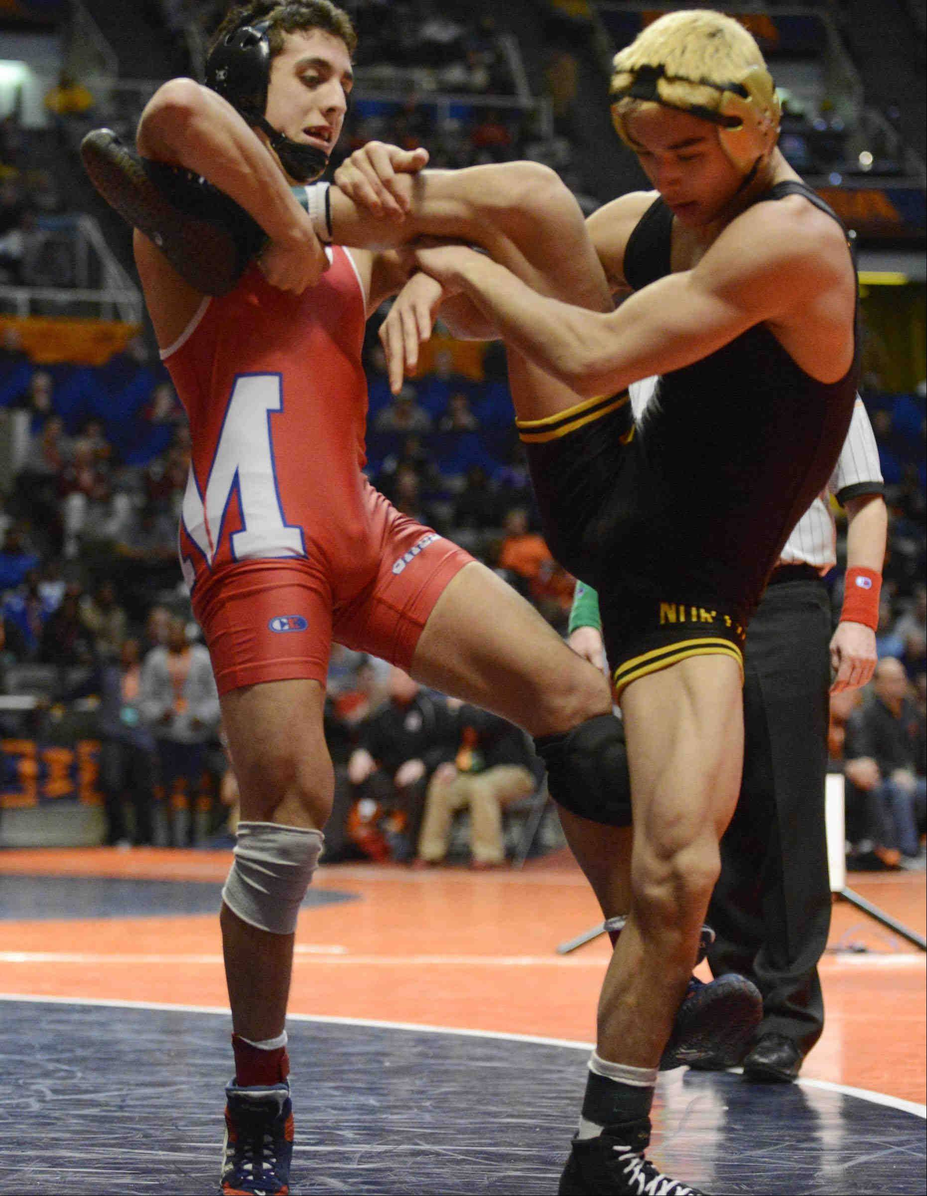 Marmion Adademy's Johnny Jimenez wrestles Jon Marmelejo of Glenbard North Friday in the 120-pound Class 3A IHSA semifinal wrestling match at Assembly Hall in Champaign. Jimenez won.