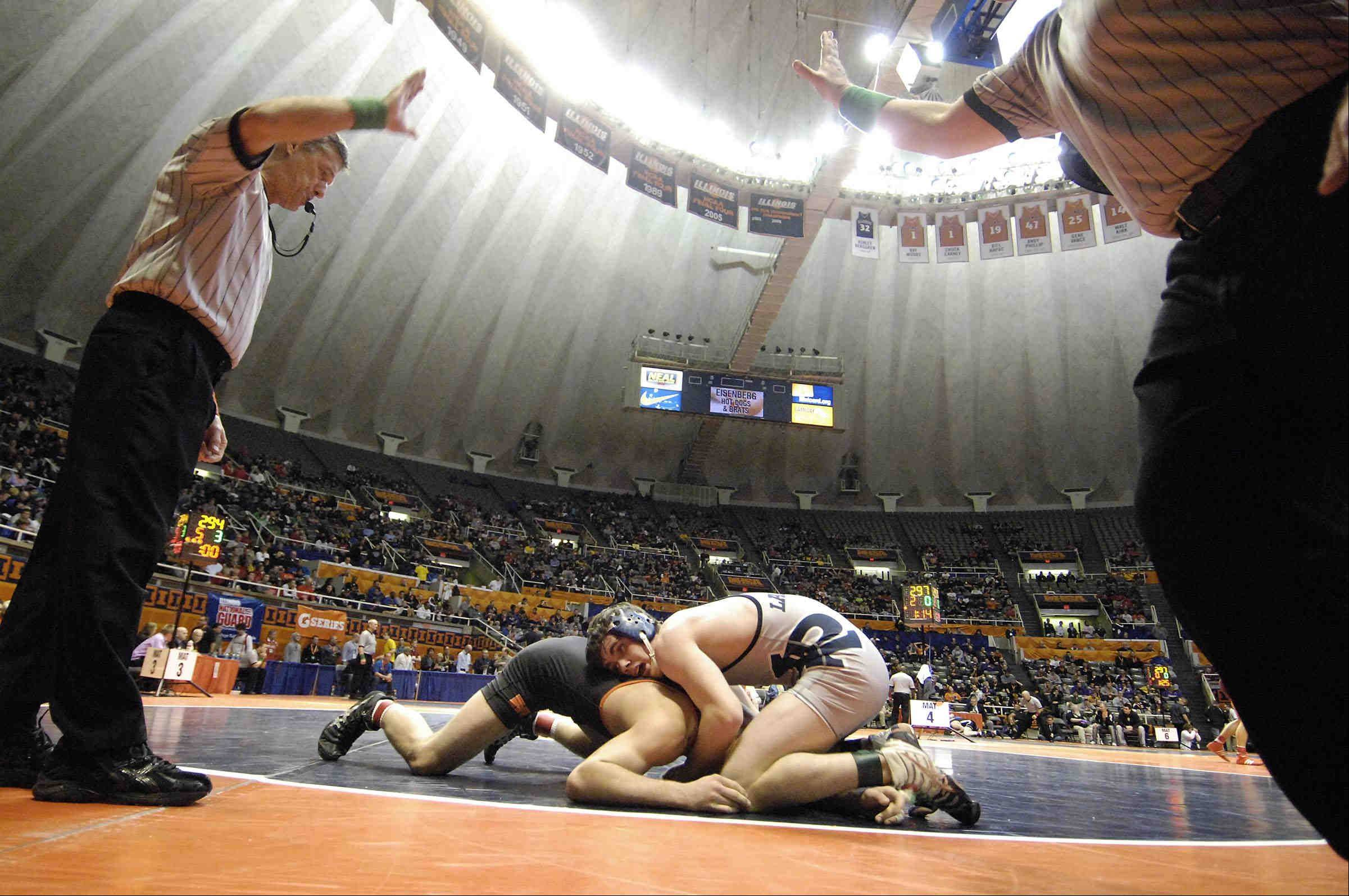 The referee blows the whistle on Lake Park's Austin Schoen as he loses by two points to Wade Lardy of McHenry Friday in the Class 3A 145-pound IHSA semifinal wrestling match at Assembly Hall in Champaign.