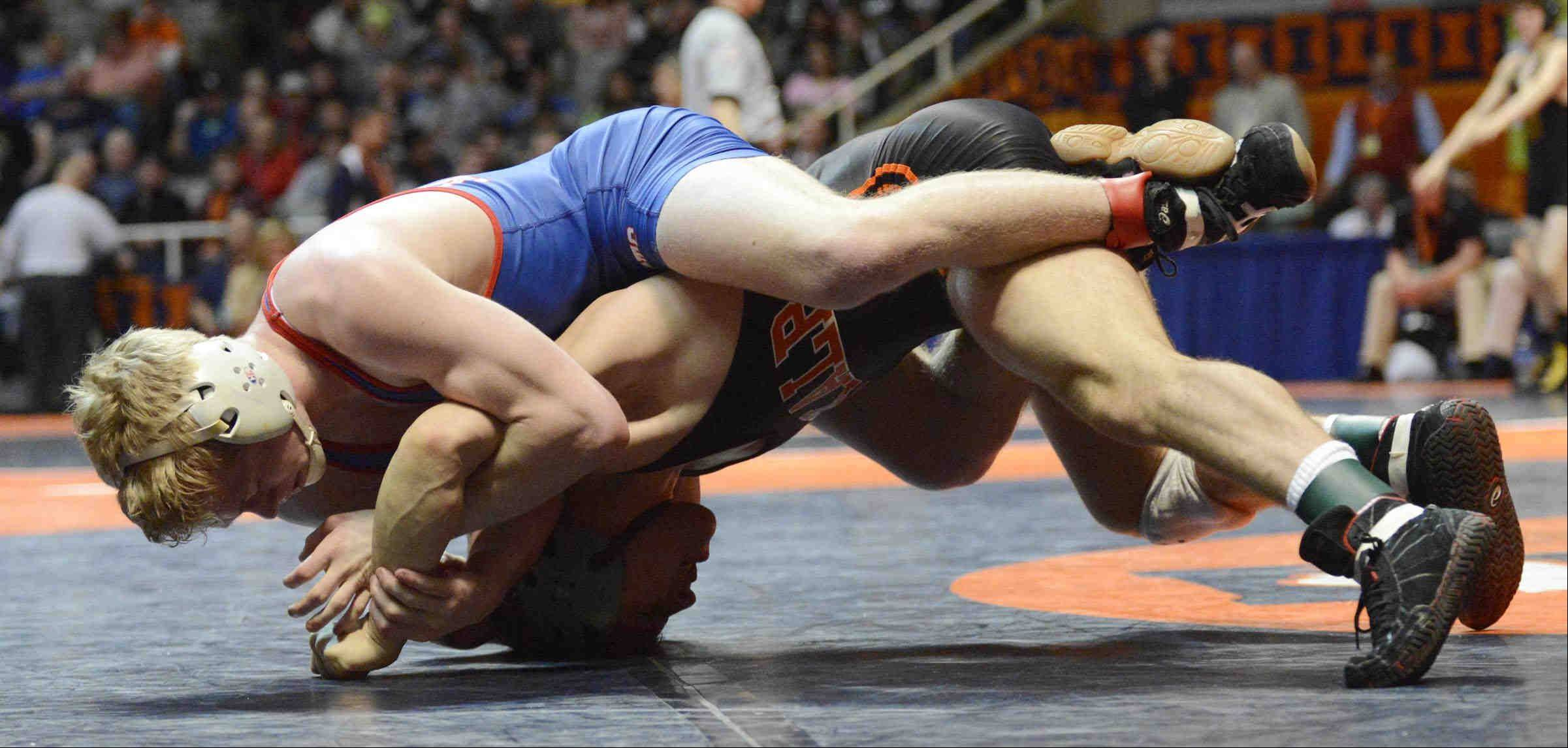 Marmion Academy's George Fisher beats Doug Johnson of Dekalb Friday in the 132-pound Class 3A IHSA semifinal wrestling match at Assembly Hall in Champaign.