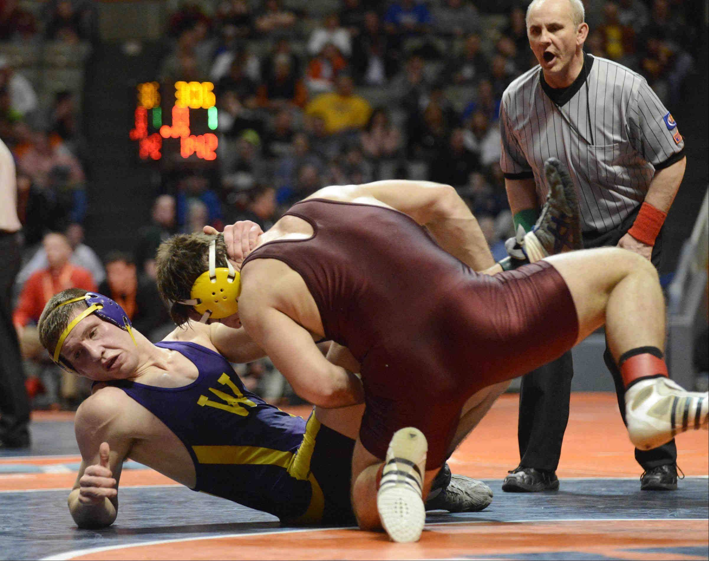John Starks/jstarks@dailyherald.com Wauconda's Nate Magiera takes a loss to East Peoria's Luca Joseph in the 220 pound Class 2A match Friday in the IHSA semifinal wrestling match at Assembly Hall in Champaign.