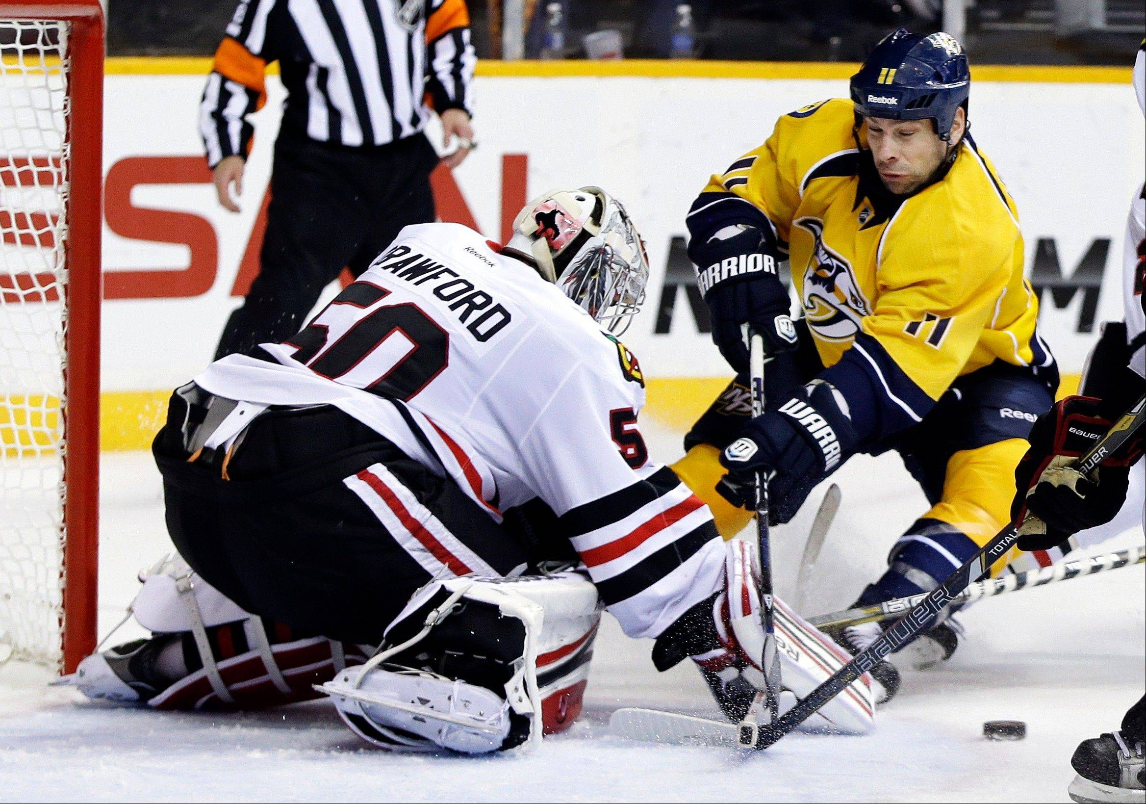 Blackhawks goalie Corey Crawford blocks a shot by Predators center David Legwand in the second period on Sunday at Nashville.