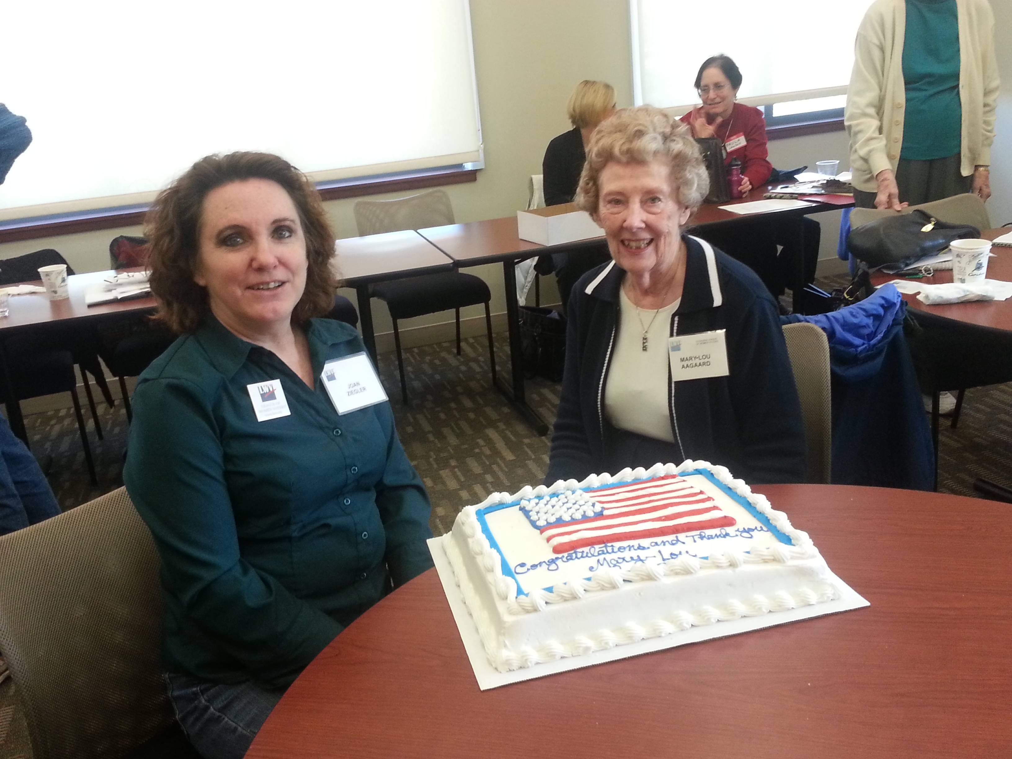 Joan Ziegler, President of League of Women Voters of Glenview, honors Mary-Lou Aagaard, recipient of 2012 Paul Simon Award