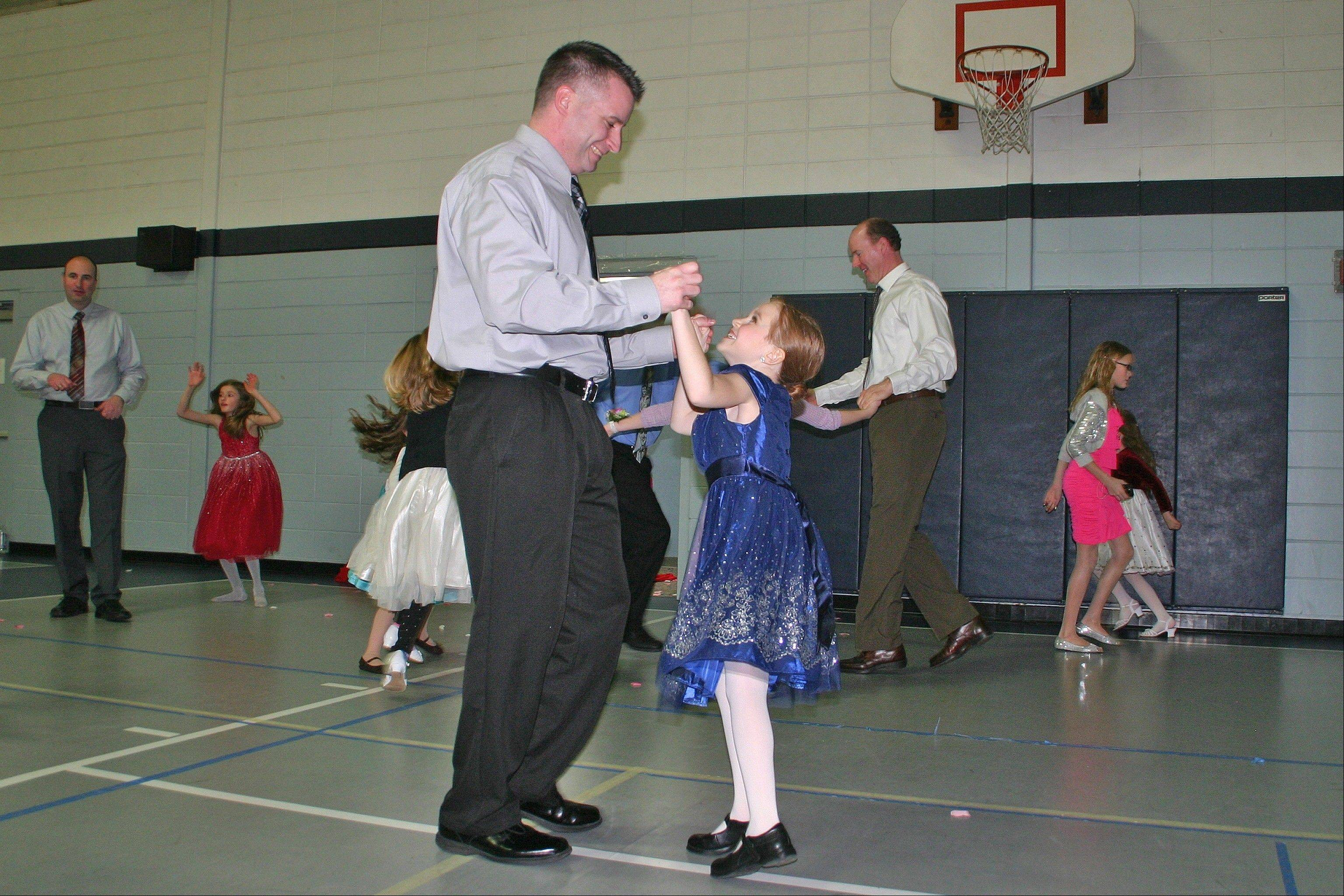 Marissa Levin only has eyes for her father, David, at the Des Plaines Park District annual Royal Ball on Feb. 9.