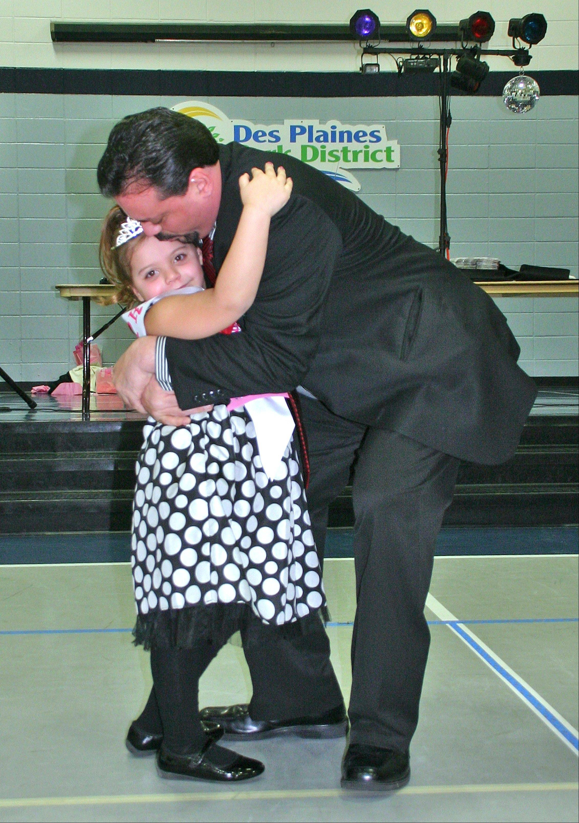 Demian and Ella LaPointe waltz at the Royal Ball on Feb. 9.