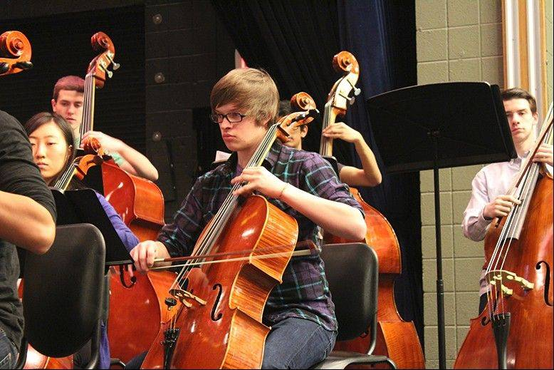 Cellos and basses practice for the Feb. 9 concert at Conant High School.