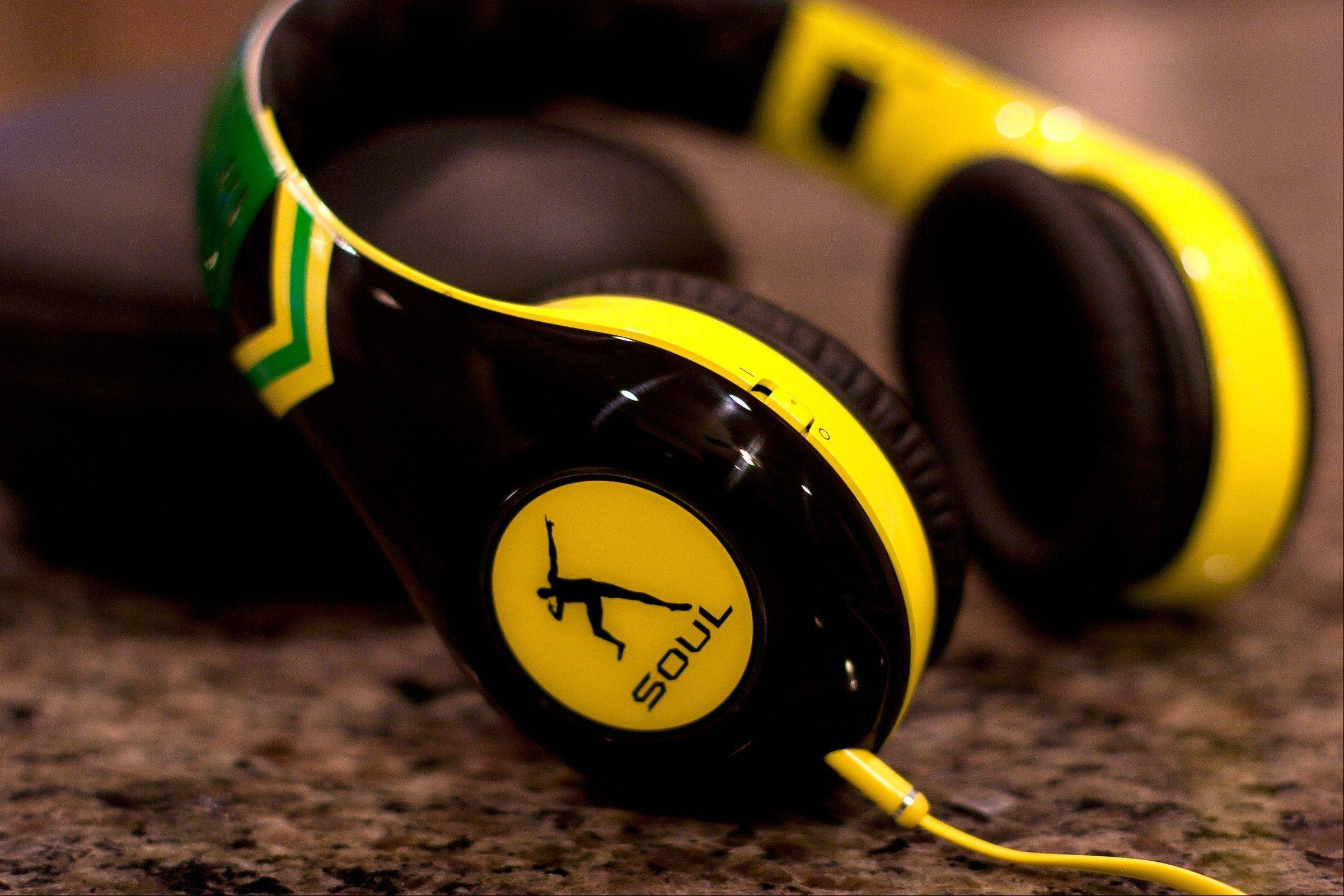 A pair of headphones from SOUL by Ludacris. The Usain Bolt signature model headphones feature noise-canceling technology, 40 mm drivers and collapsible construction.(AP Photo/Ron Harris)