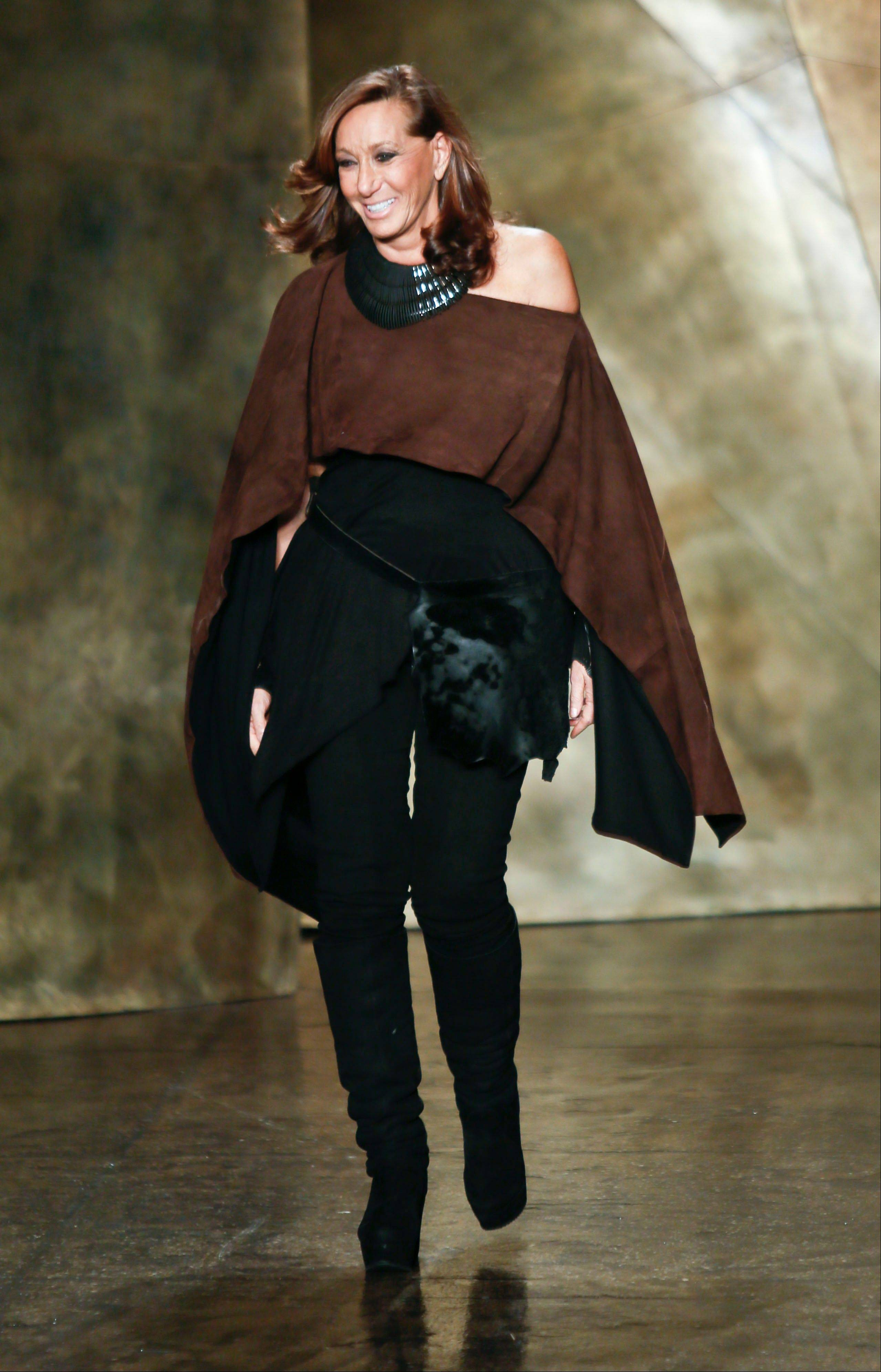 Fashion designer Donna Karan New York appears on the runway after showing her Fall 2013 collection on Monday in New York.