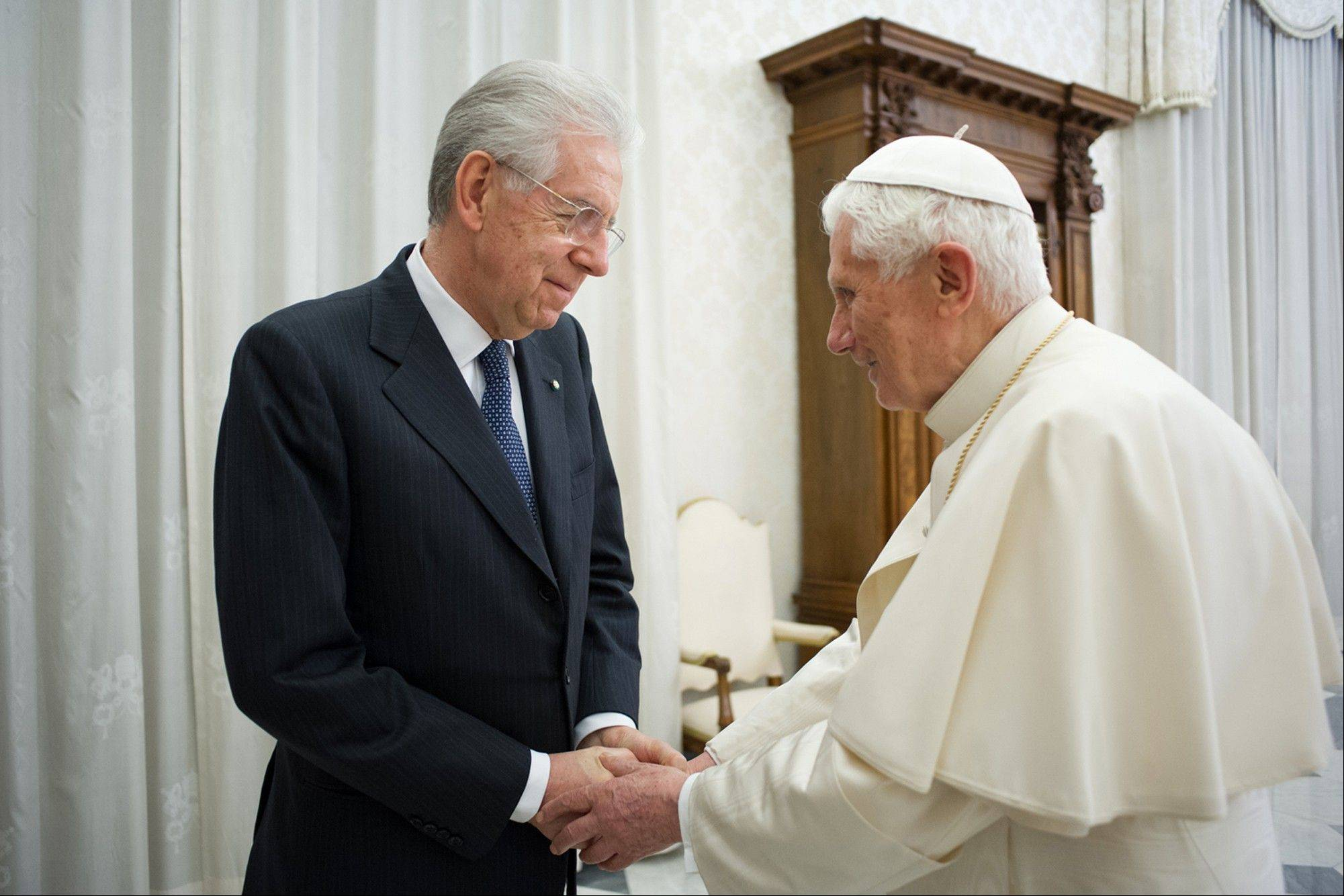 Pope Benedict XVI shakes hands Saturday with Italian Premier Mario Monti during a private audience at the Vatican.