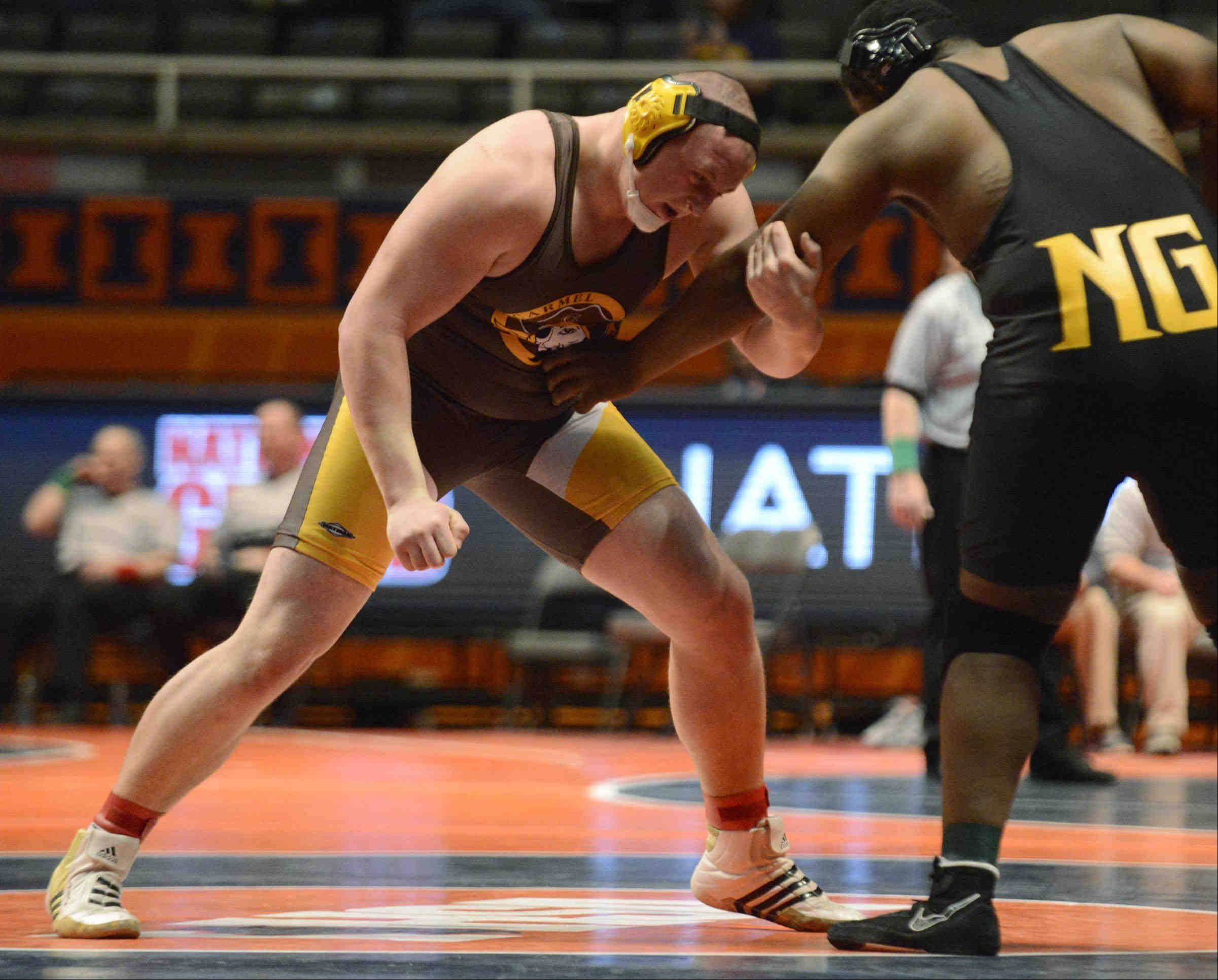Jake Cochrane of Carmel faces Lovontay Cobb of Chicago King in the Class 2A 285-pound IHSA third-place match at Assembly Hall in Champaign.
