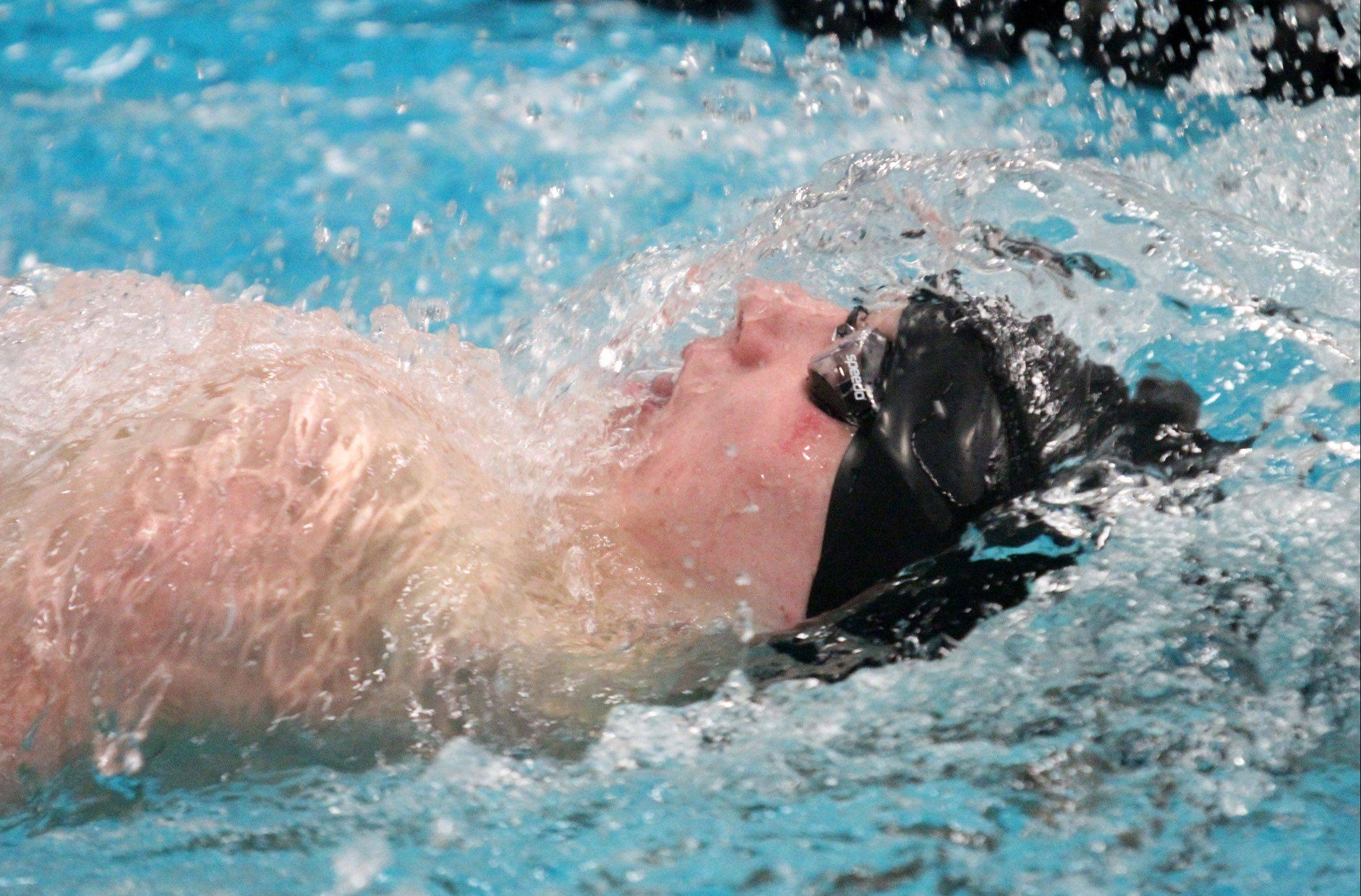 St. Charles North�s Josh Clay swims the 200-yard individual melody at the sectional swim meet at St. Charles East on Saturday.