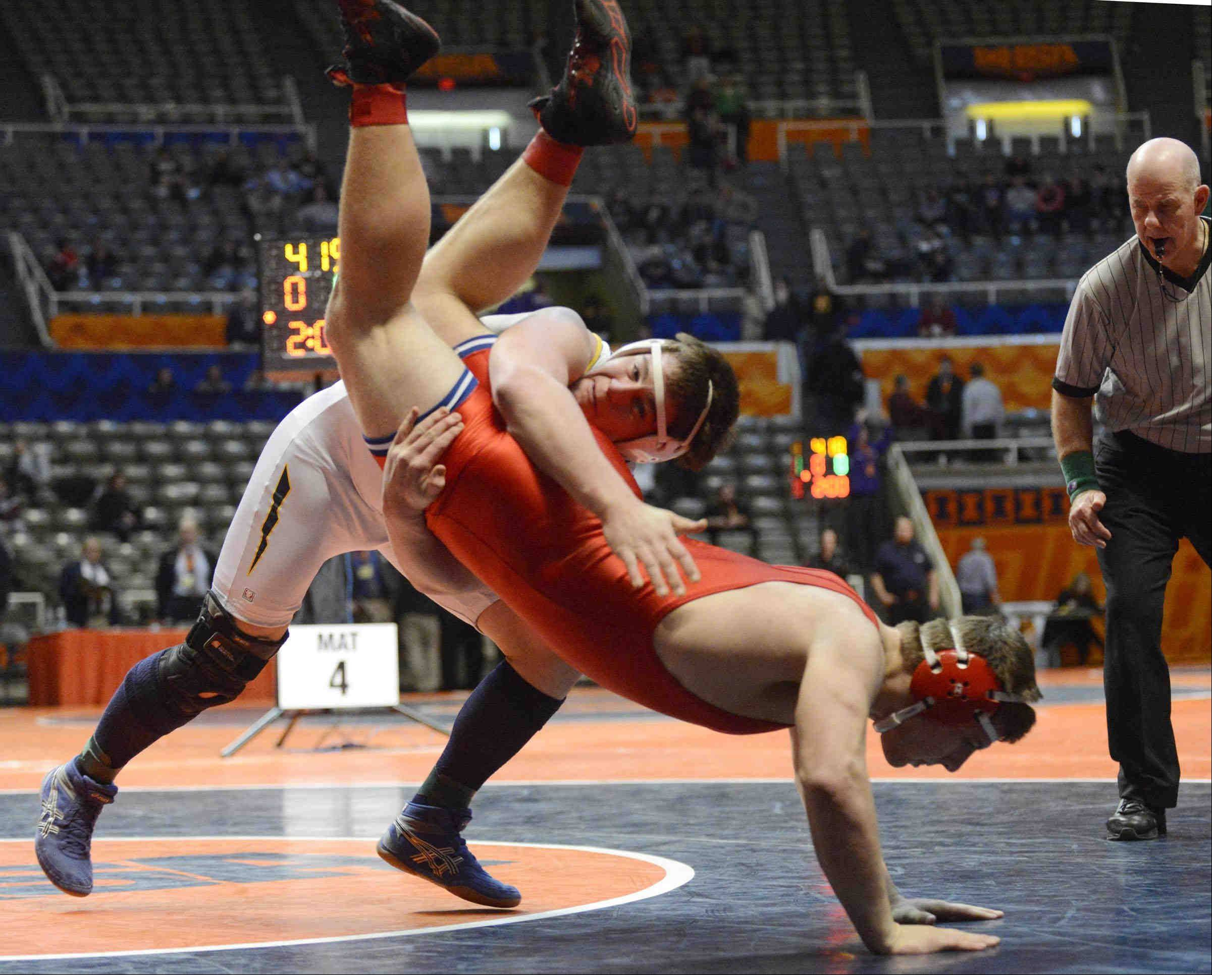 Dundee-Crown�s Ray Griggel controls his position as Jacob Suter of Glenbrook South tries to take control in the Class 3A 220-pound IHSA third place wrestling match at Assembly Hall in Champaign. Suter won and Griggel took fourth place.