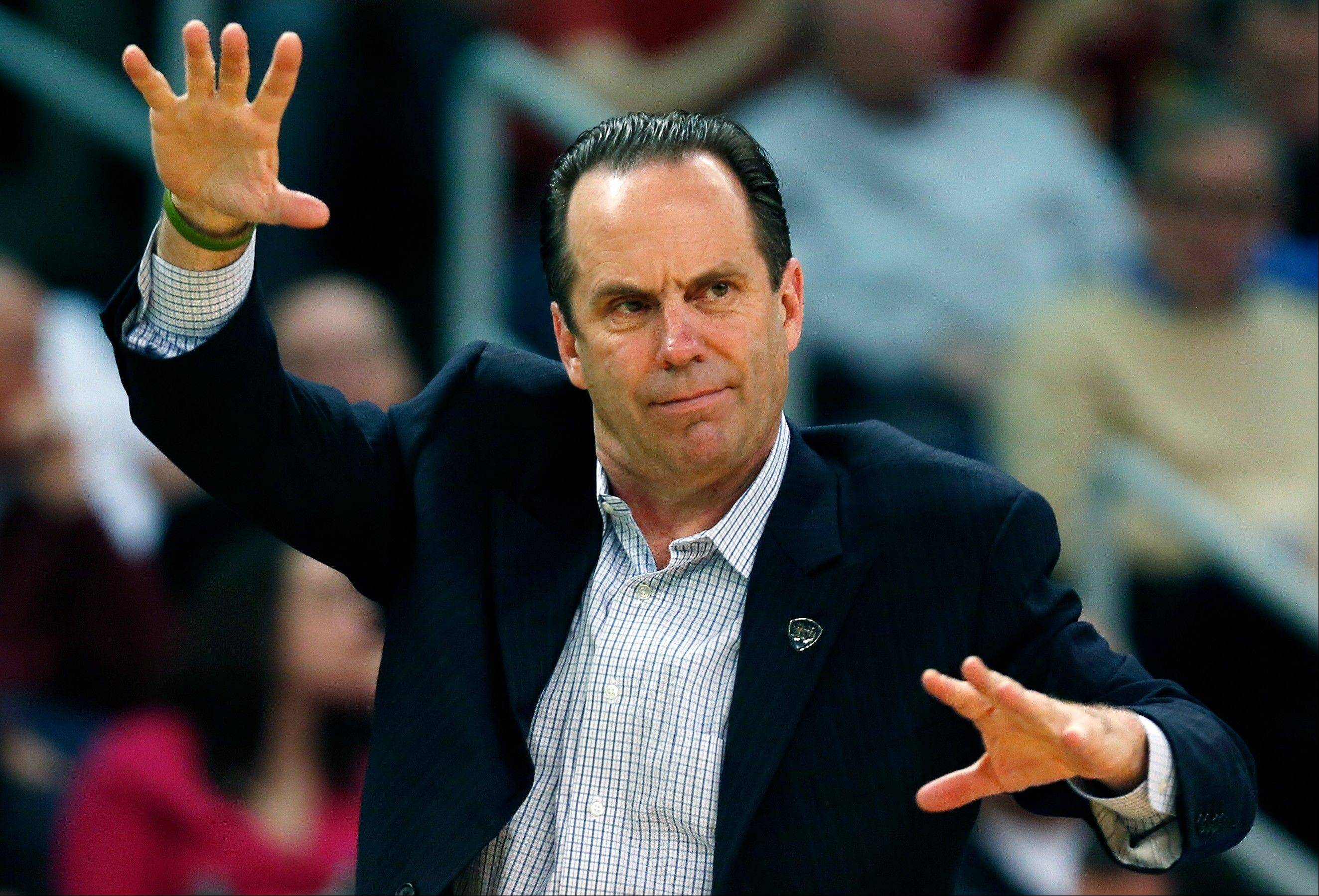 Notre Dame head coach Mike Brey signals his team in the second half.