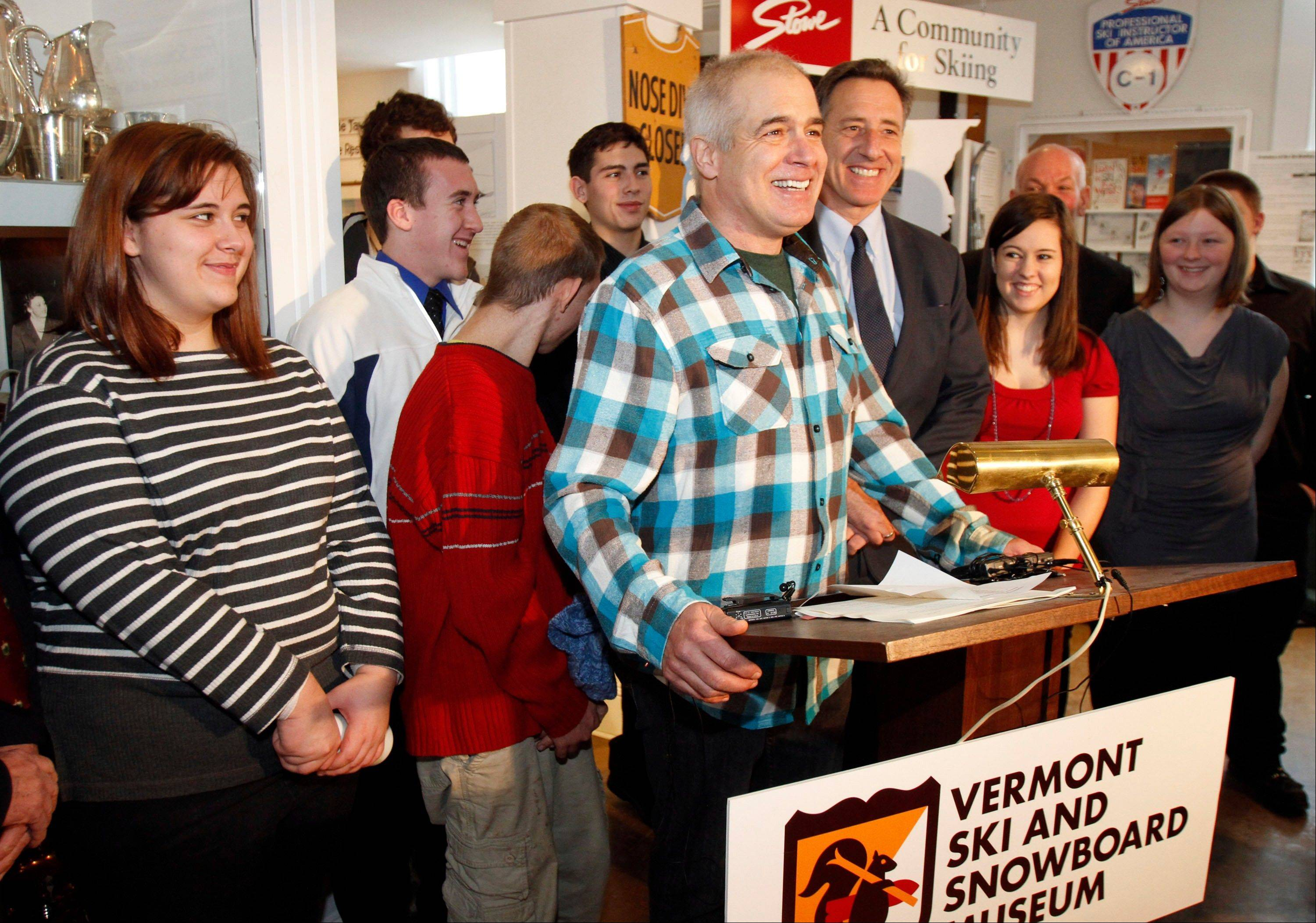Jake Burton, the creator of Burton Snowboards, center, speaks during a bill signing with Gov. Peter Shumlin, right, in Stowe, Vt. Recent studies by industry groups show snowboarding is no longer growing the way it was for its first 30 years.