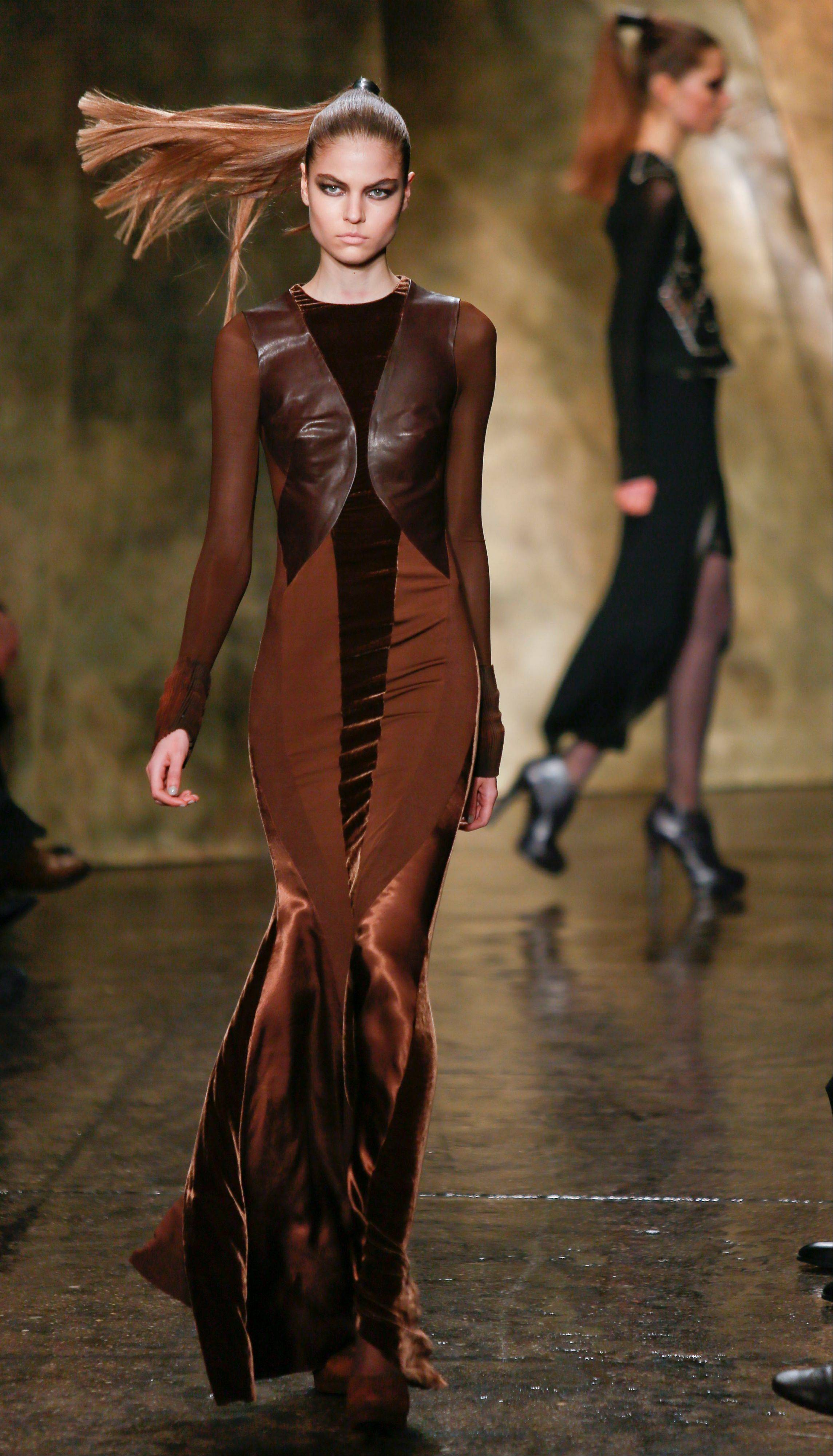 Fashion from the Fall 2013 collection of Donna Karan New York is modeled on Monday in New York.
