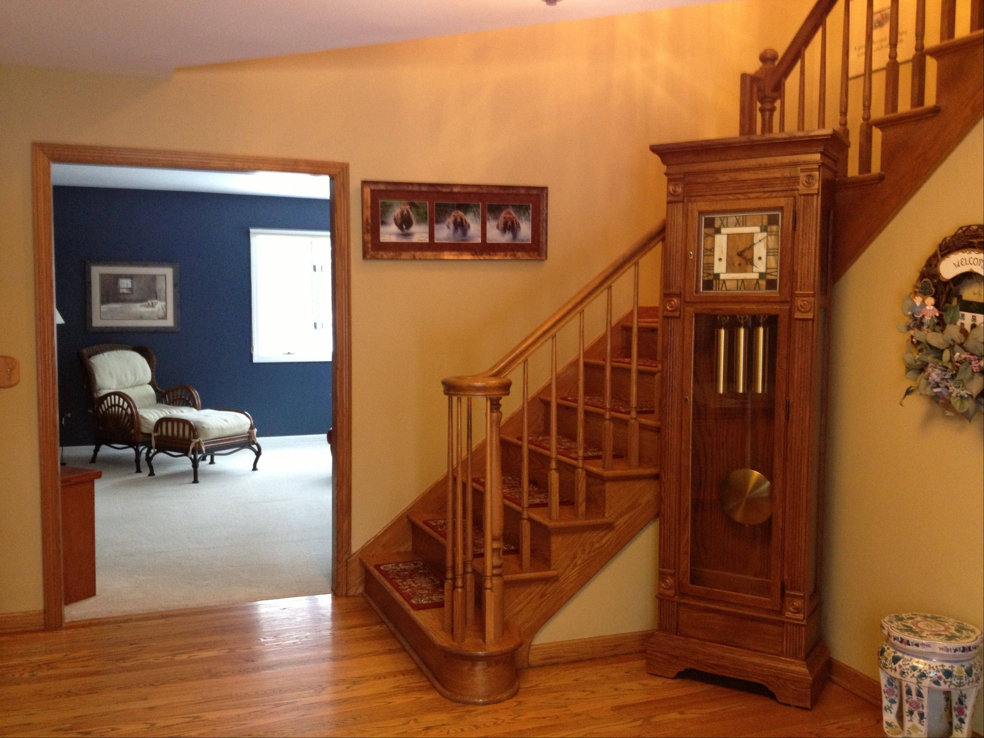 Stairs in the two-story foyer lead up to the second floor and a newly finished master suite.