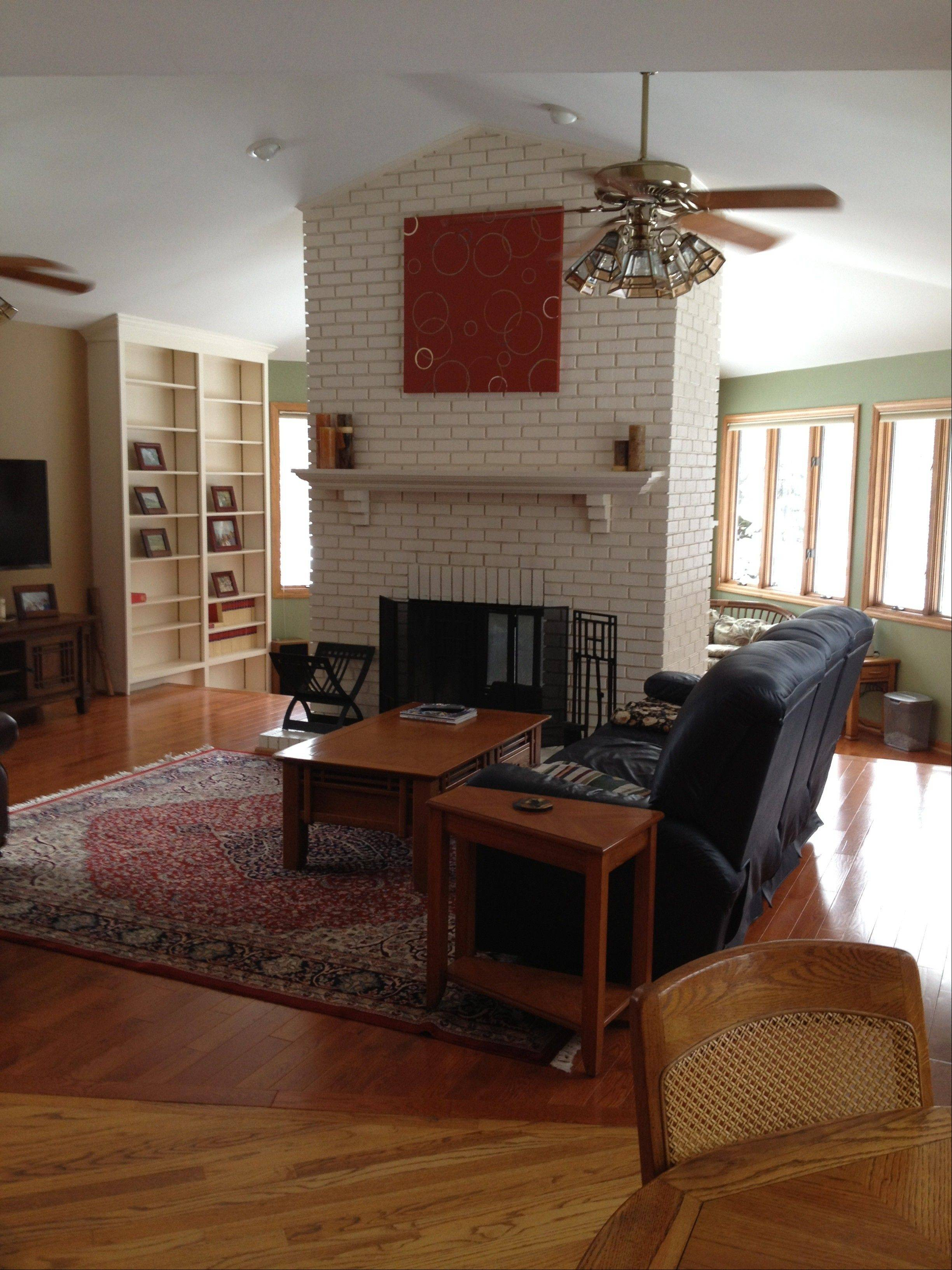 The family room features a double-sided fireplace.