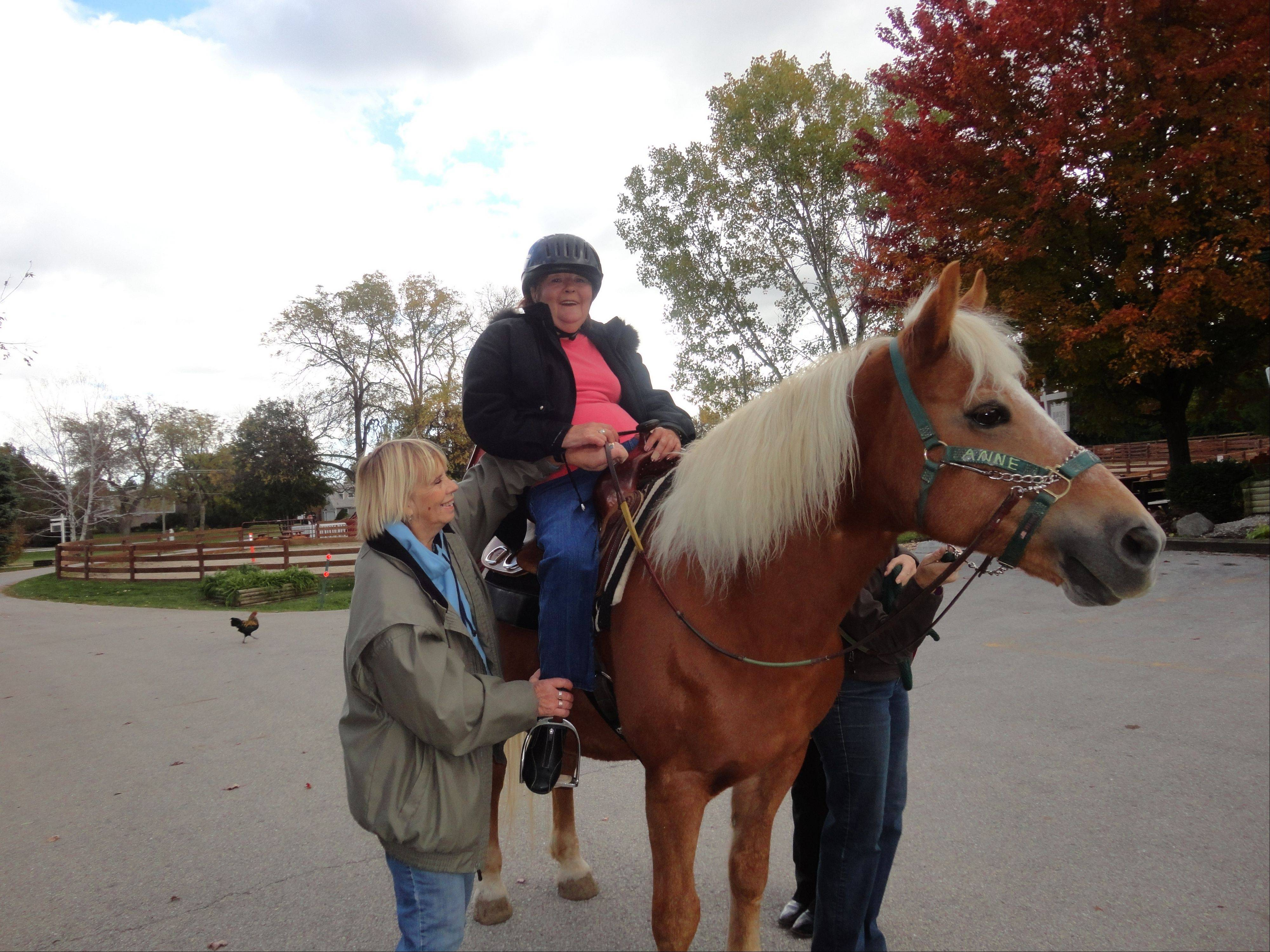 Garrigus, a resident of Victory Centre of River Woods, takes advantage of opportunities to go horseback riding at the Hanson Center Riding Arena in Burr Ridge.