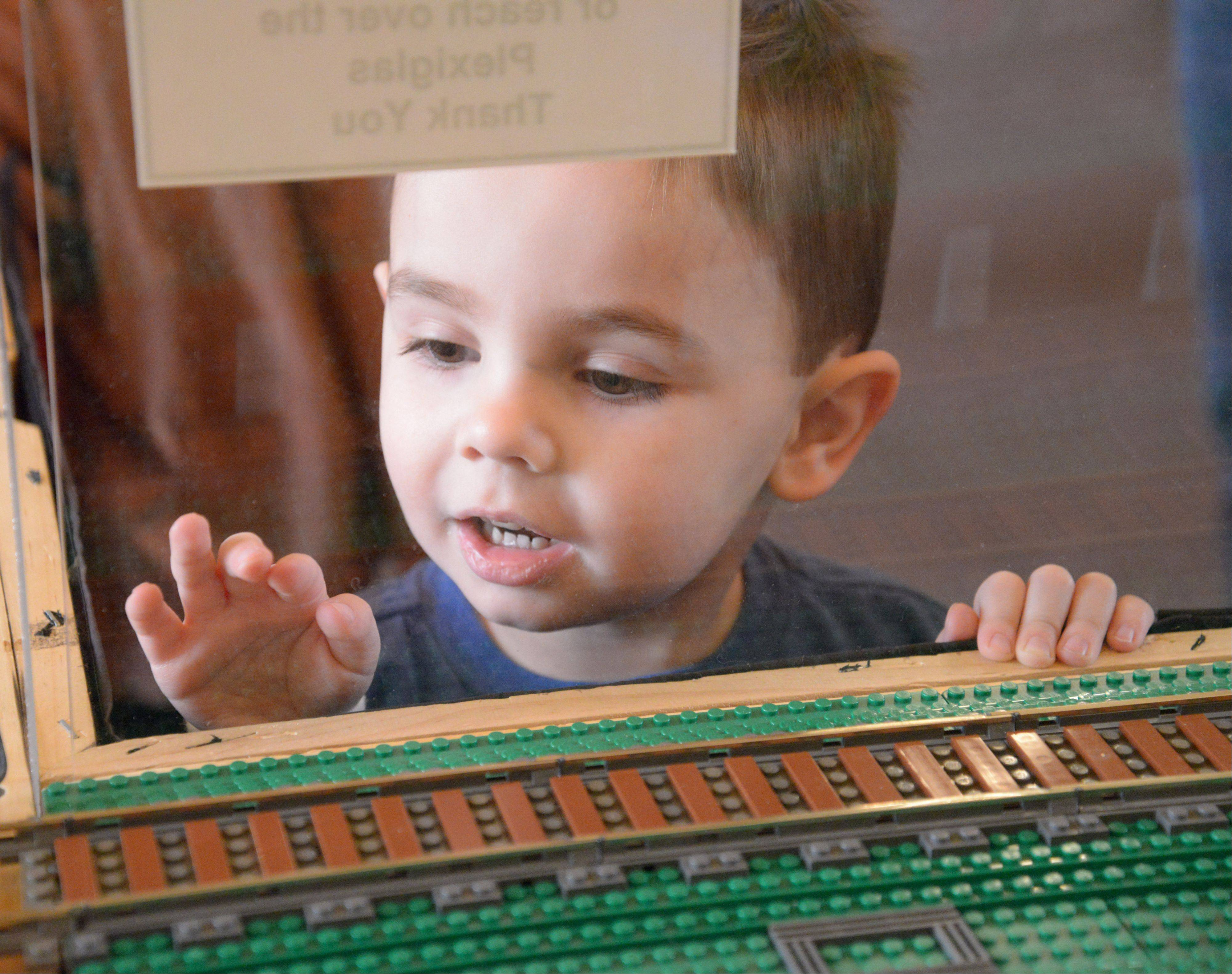 Roger Shorney, 4, of Wheaton can't get enough Lego while visiting the Northern Illinois Lego Train Club's show Saturday at the DuPage County Historical Museum in Wheaton. The event continues Sunday.