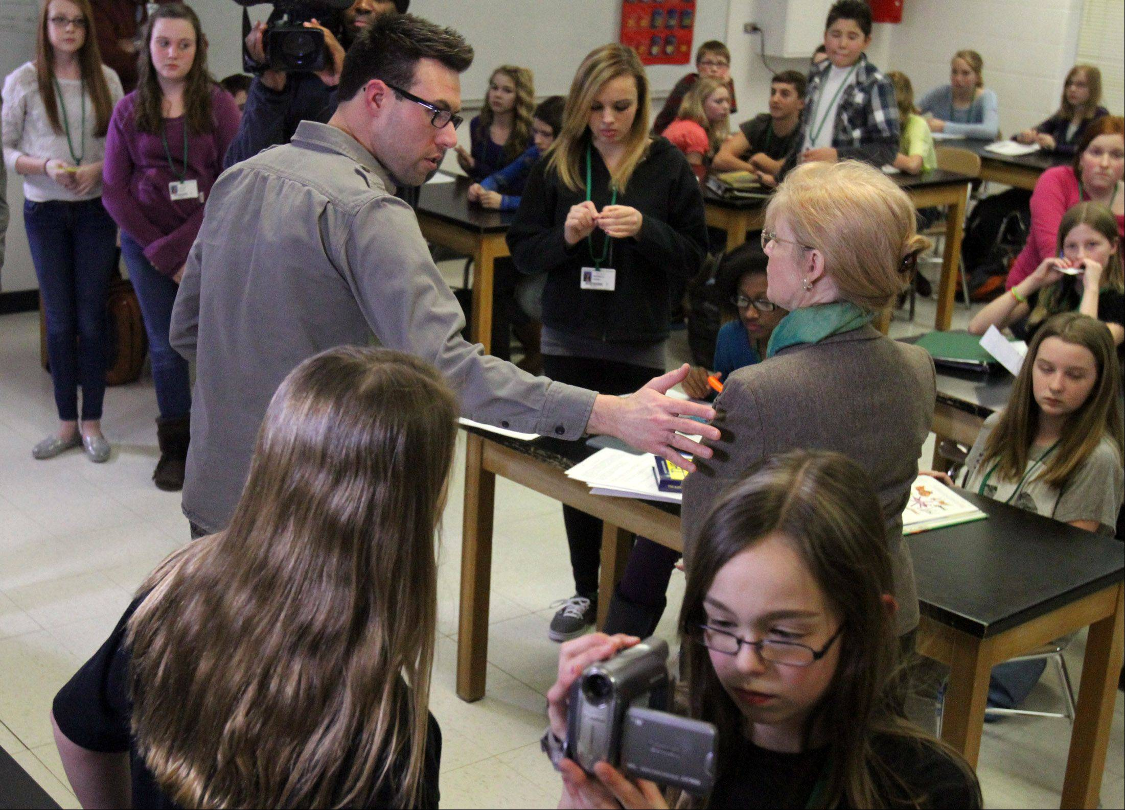 Matt Till, a Columbia College instructor, directs Woodland Middle School teacher Ellen Crahan for a video shot at the school in Gurnee on Friday.