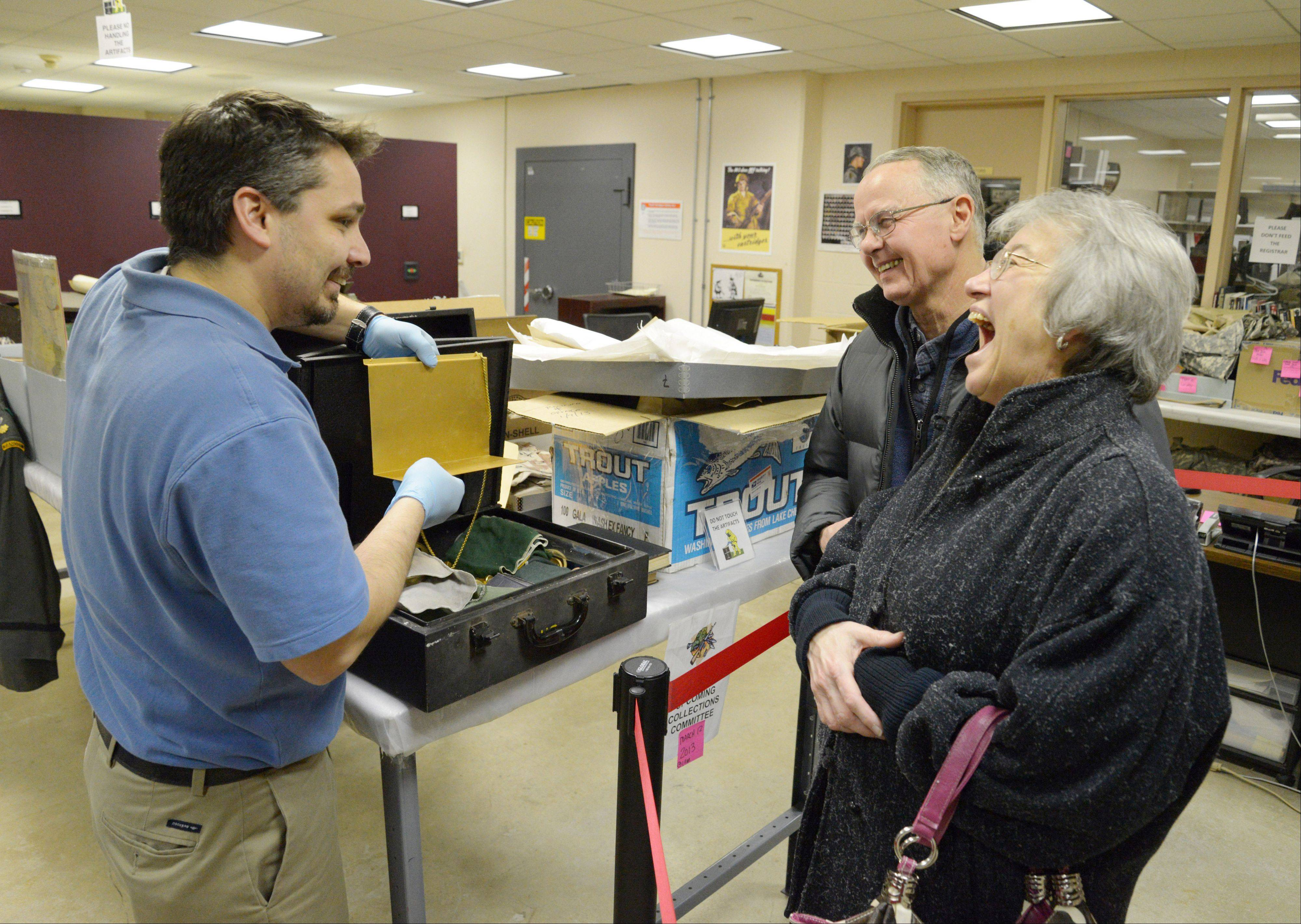 John Maniatis, registrar of the First Division Museum at Cantigny Park in Wheaton, shows Don and Martha Kretzschmar of Wheaton a Vietnam-era chaplain kit.