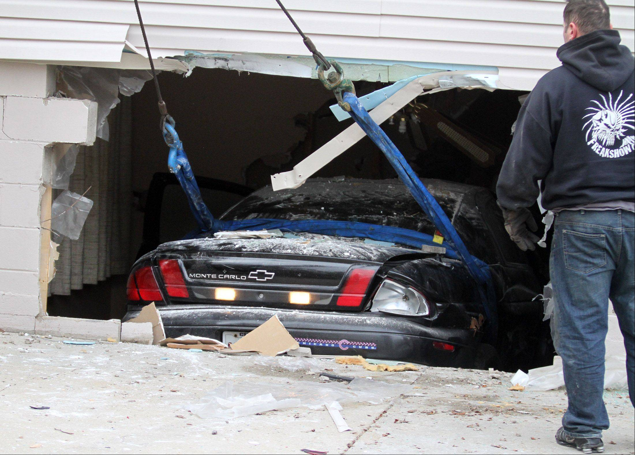 Geraldine Gibb had left her basement moments before this Chevy Monte Carlo, driven by an unidentified male, crashed through the wall.