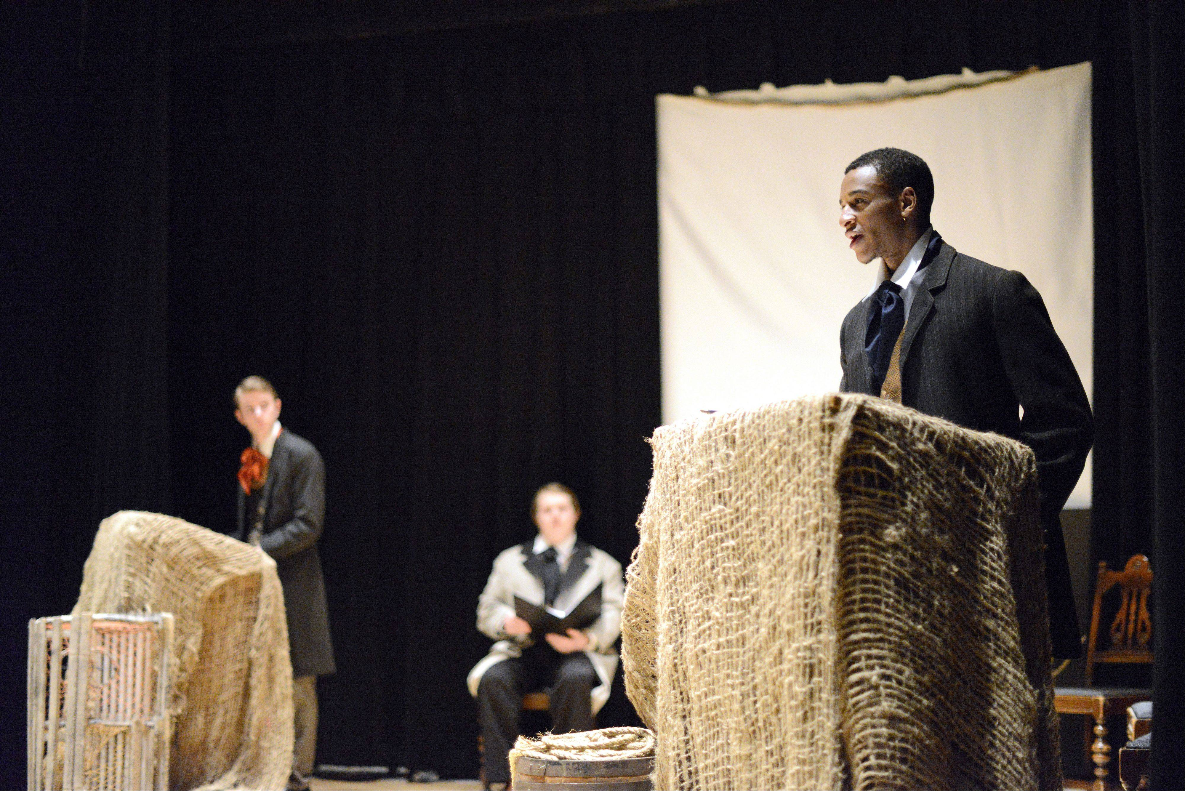 "Julien Moore, 22, of Elgin portrays Olaudah Equiano in Elgin Community College's production of ""Voices of the Middle Passage."" The one-act play about the slave trade affected Moore emotionally. He already knew a lot about the history but was struck by details of the life of Equiano, who ultimately bought his freedom."