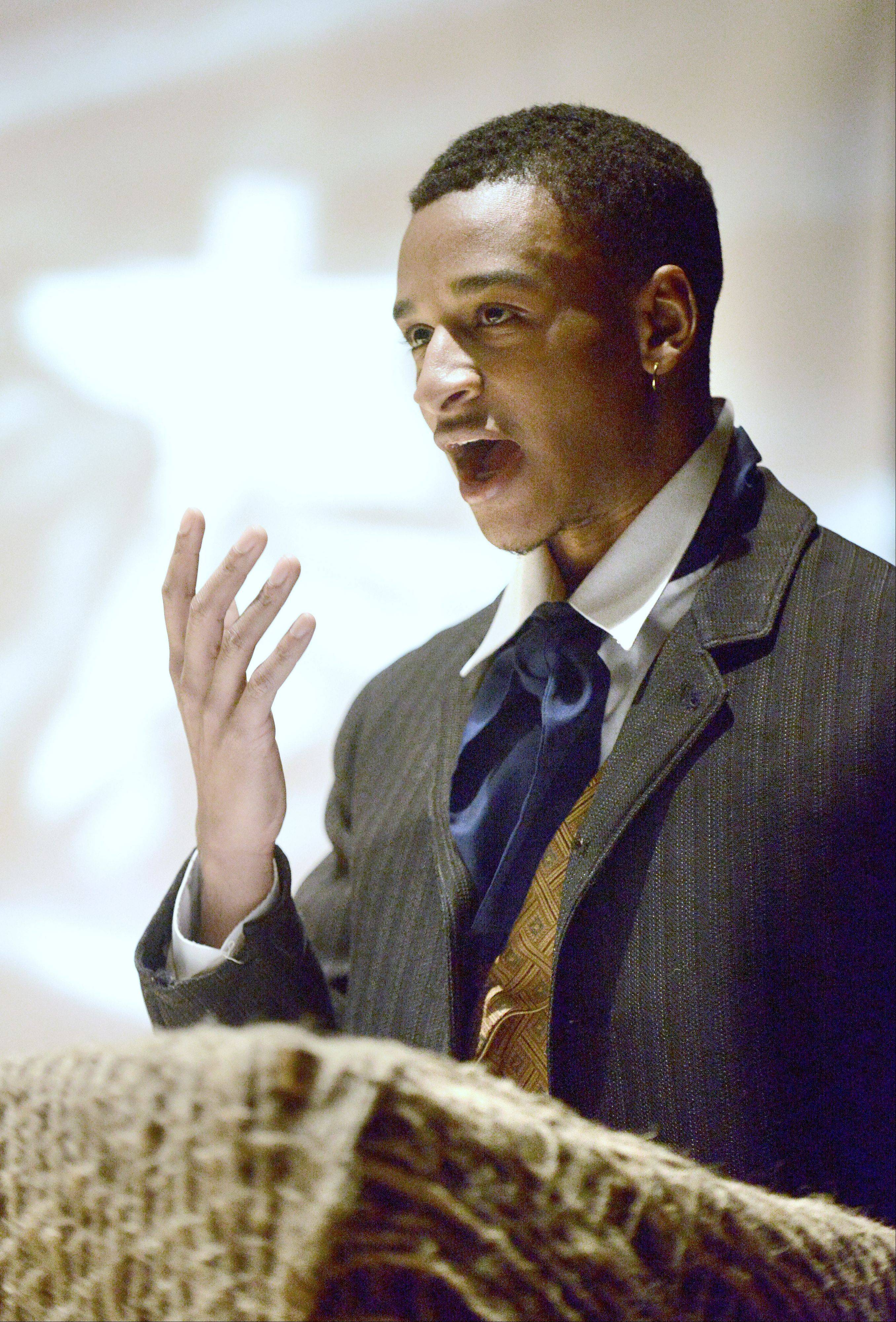 "Julien Moore, 22, of Elgin portrays Olaudah Equiano in Elgin Community College's production of ""Voices of the Middle Passage."" The one-act play about the slave trade had an emotional effect on Moore, who already knew a lot about the history but was struck by details of the life of Equiano, who ultimately bought his freedom."