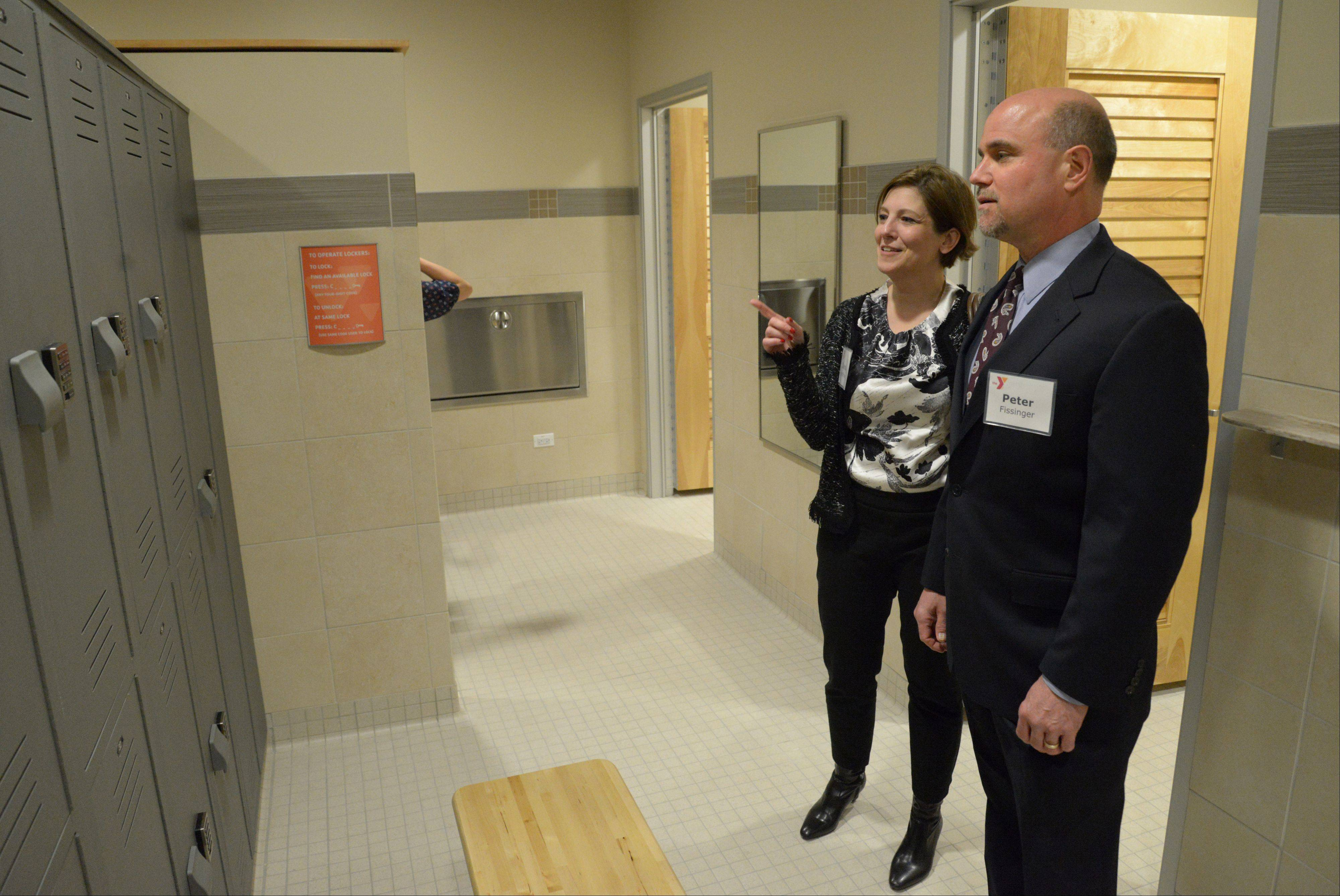 Sarai Hoffman, left, of the YMCA of Metro Chicago, and Peter Fissinger of Chicago look at the new dressing room at the Fry Family YMCA Friday as the Y unveiled its new 5,300-square-foot addition.