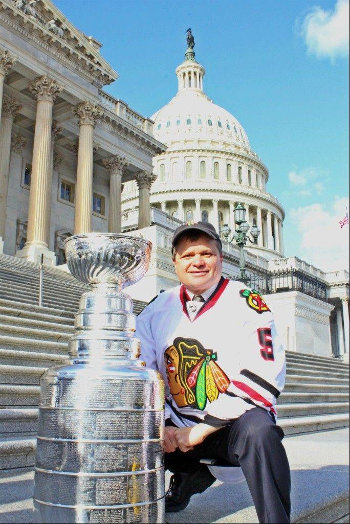 U.S. Rep. Mike Quigley, a Carol Stream native, poses with the Stanley Cup outside of the U.S. Capitol. He wears number five in honor of his district, which stretches from Chicago west to DuPage County.