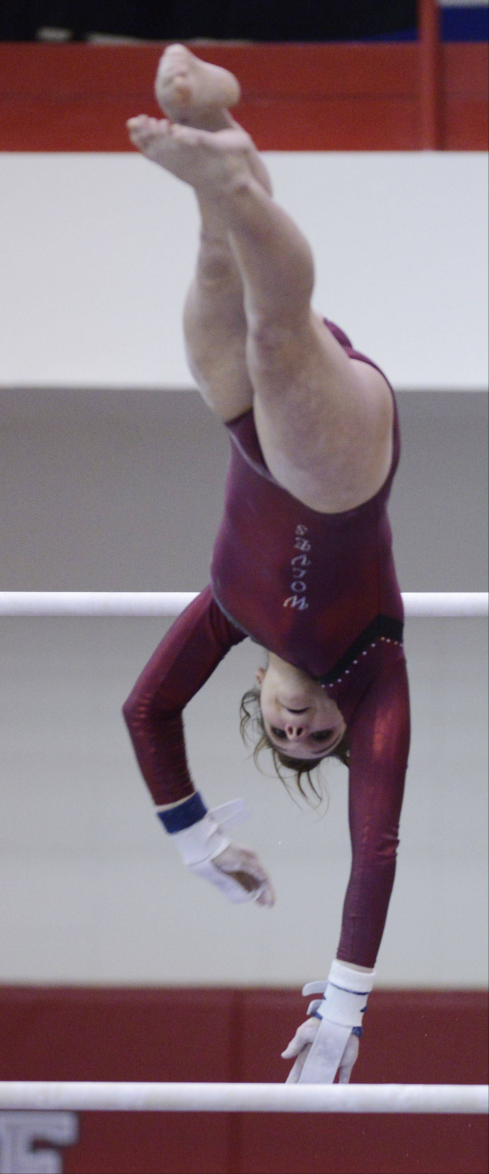 Rachael Underwood of Prairie Ridge competes on the uneven parallel bars during the girls state gymnastics finals at Palatine High School Saturday.