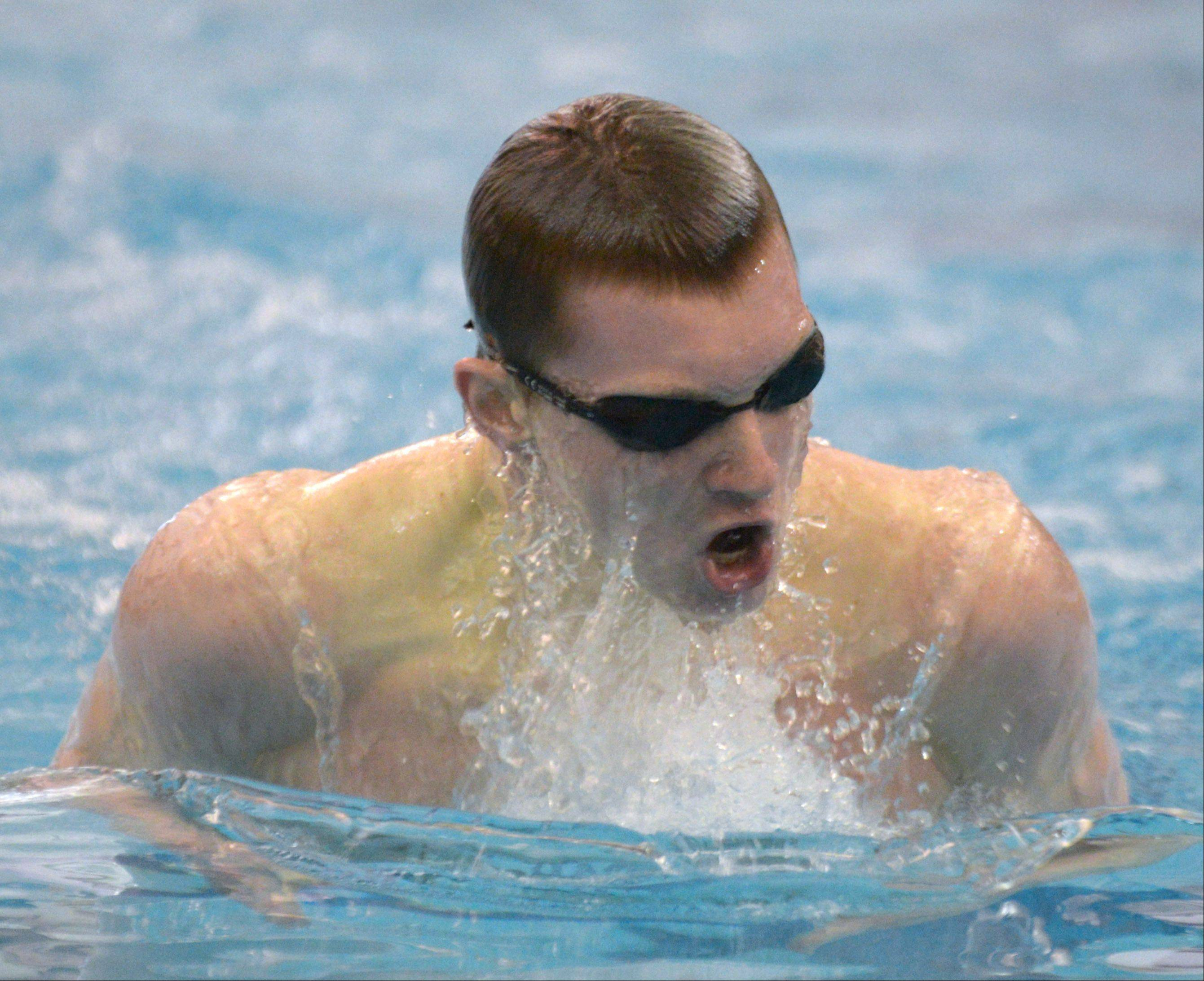 Connor Lamb of Naperville Central takes part in the 200 IM during the Neuqua Valley boys swimming sectional in Naperville Saturday.