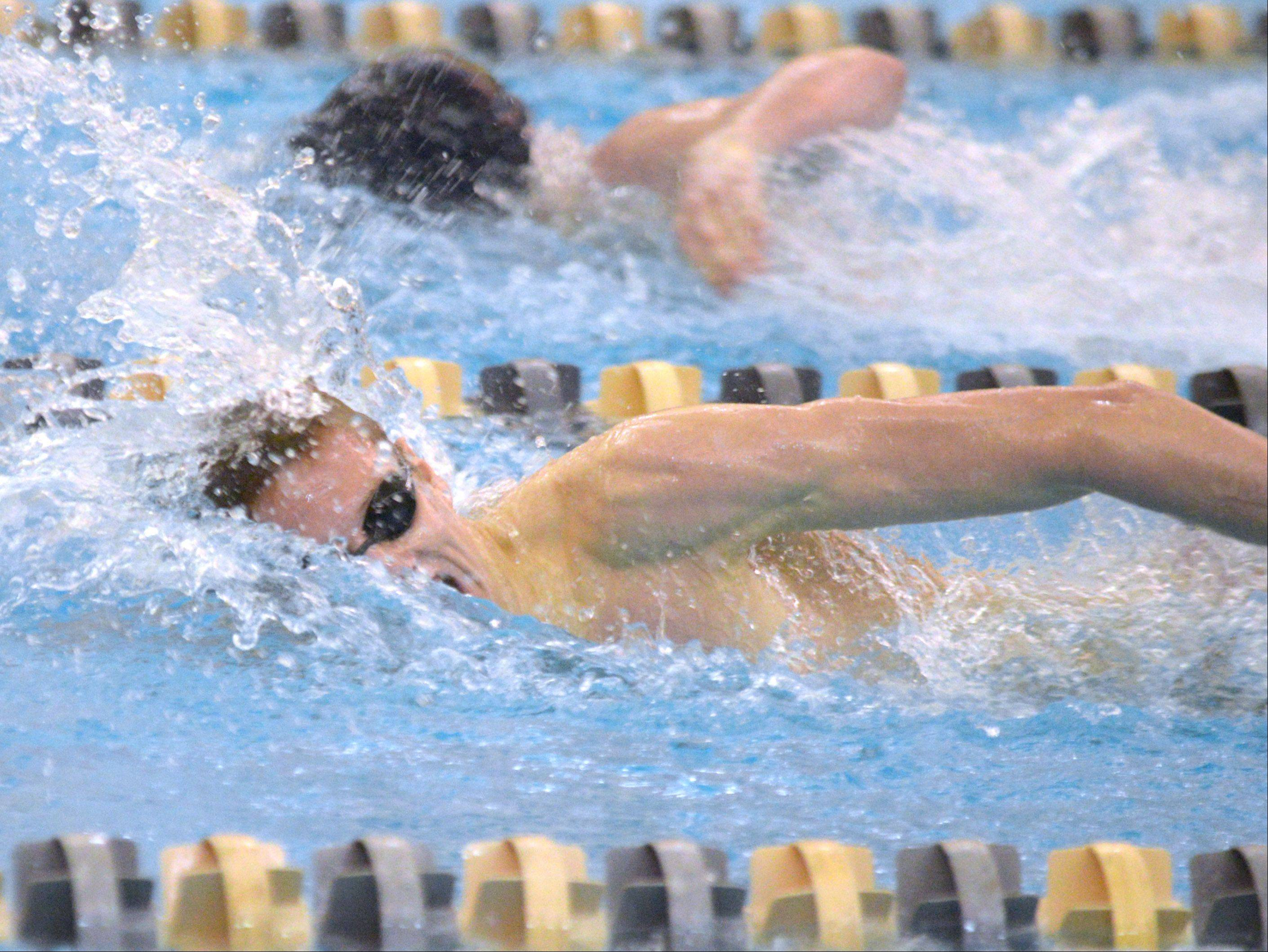 Sam Hiler of Naperville North swins the 200 free during the Neuqua Valley boys swimming sectional in Naperville Saturday.