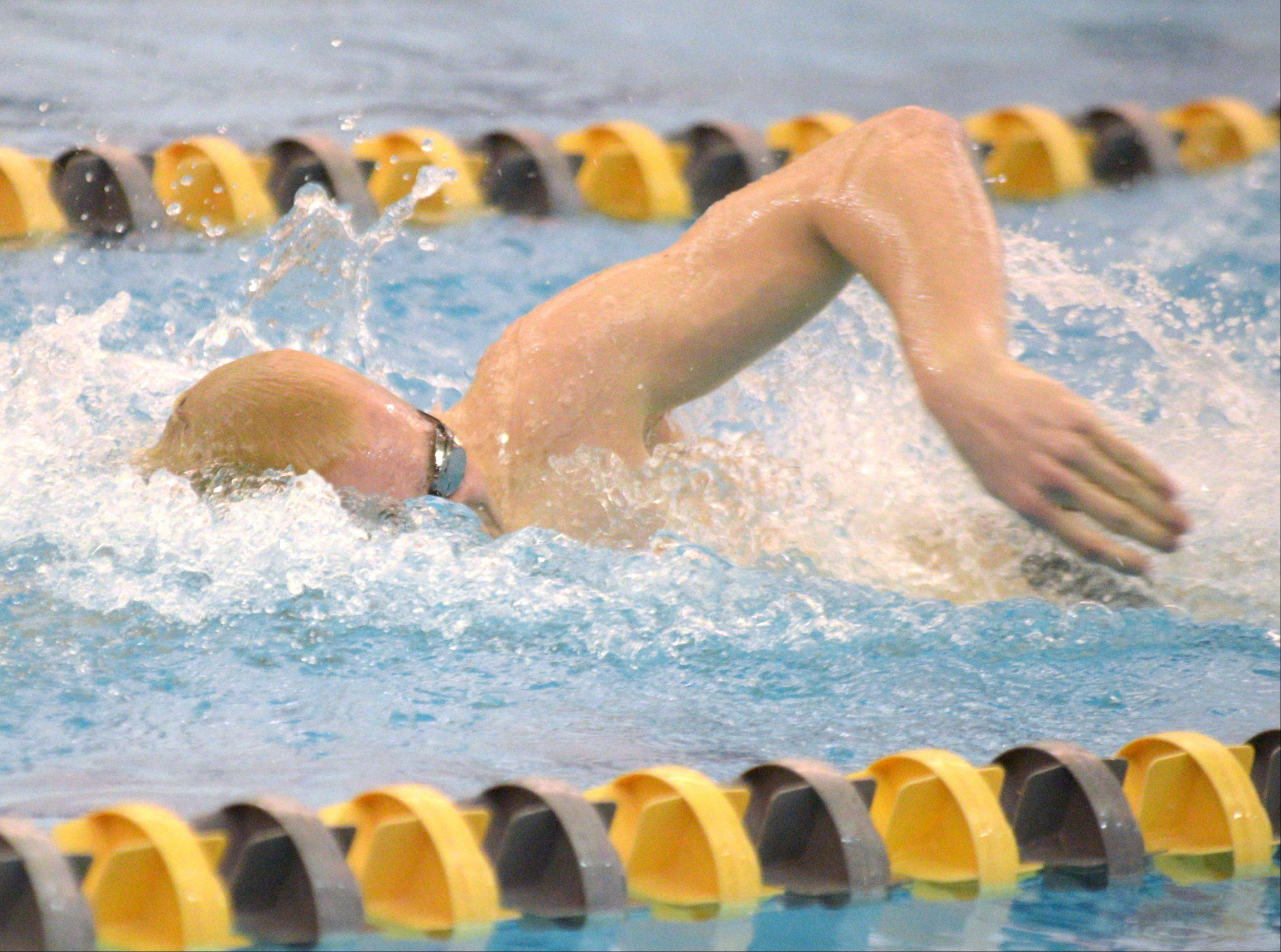 Adan Stacklin of Waubonsie Valley swims the 200 free during the Neuqua Valley boys swimming sectional in Naperville Saturday.