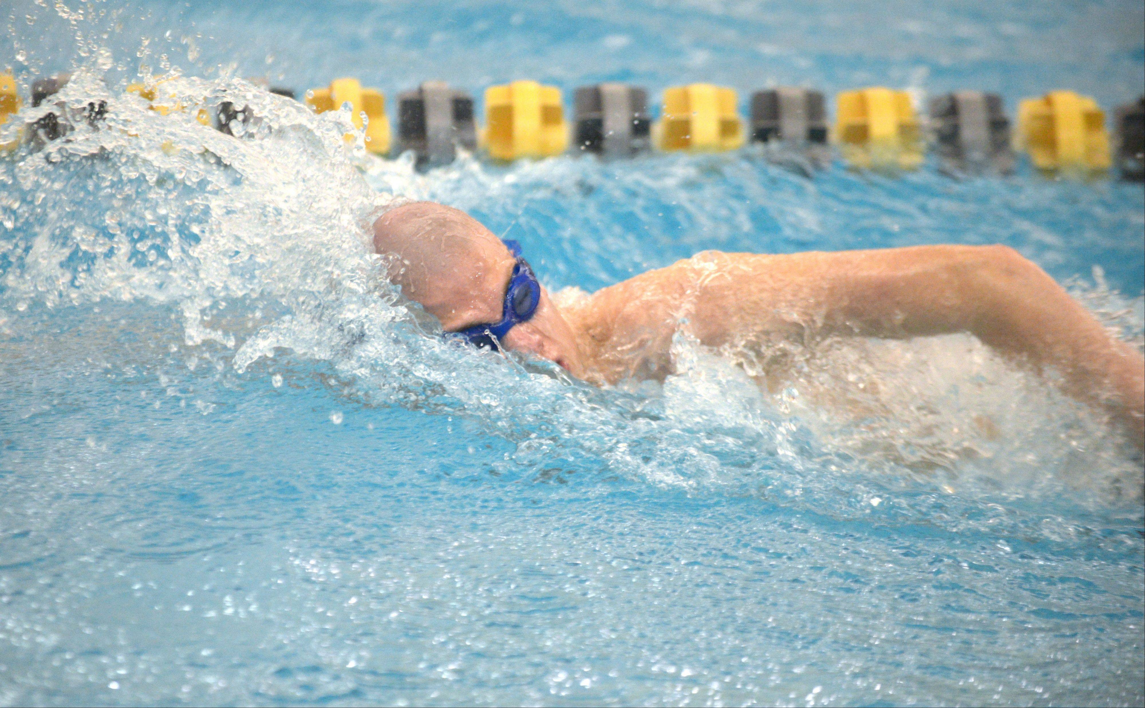 James Iglesias of West aurora swims the 20 free during the Neuqua Valley boys swimming sectional in Naperville Saturday.