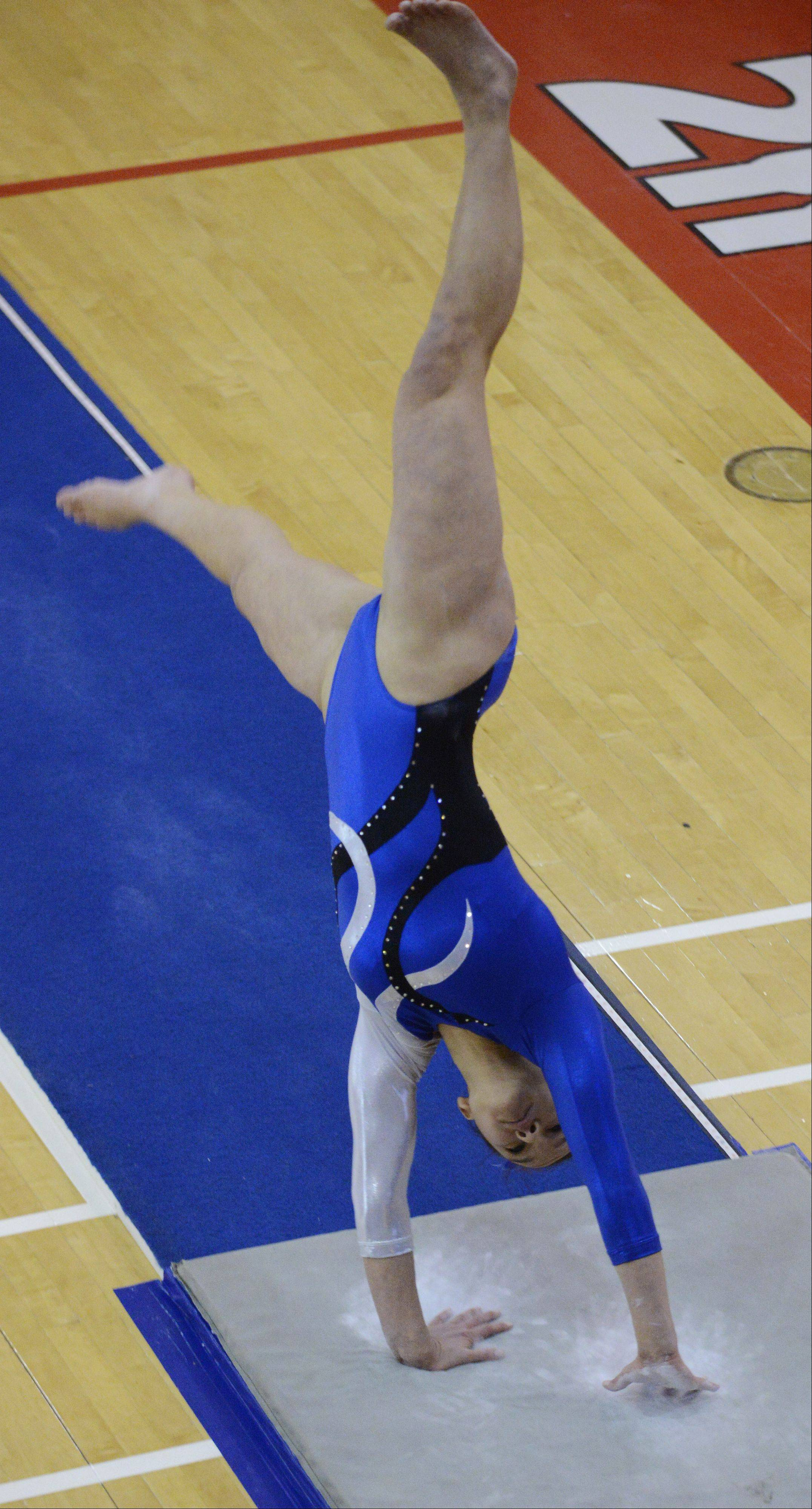 Alli Tran of Vernon Hills competes on vault during the girls gymnastics state finals at Palatine High School on Saturday.