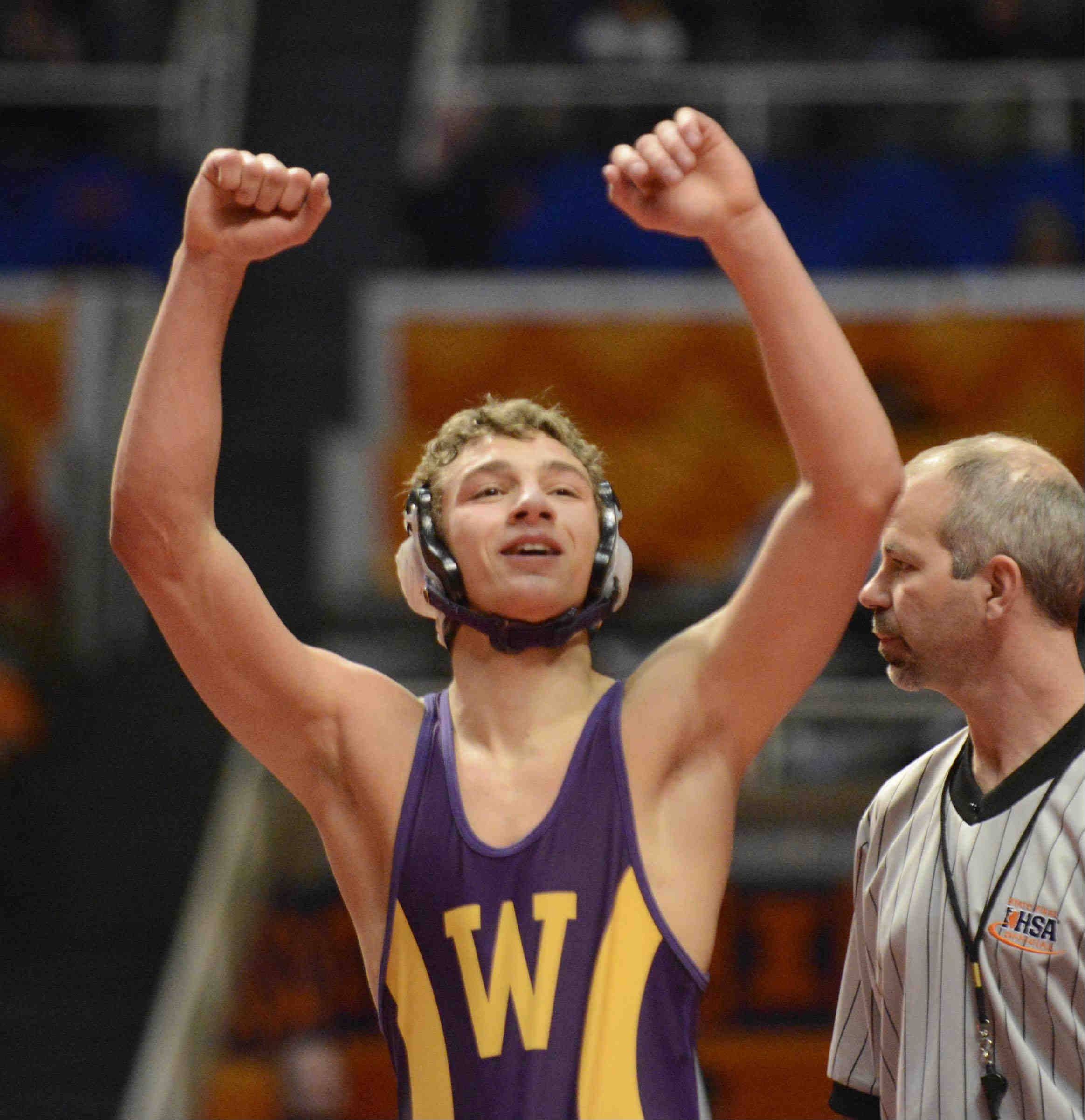 Wauconda's Devin Tortorice looks toward the crowd after winning third place against Kyle Rodruguez of Lincoln-Way West in the Class 2A 132-pound bout at Assembly Hall in Champaign.