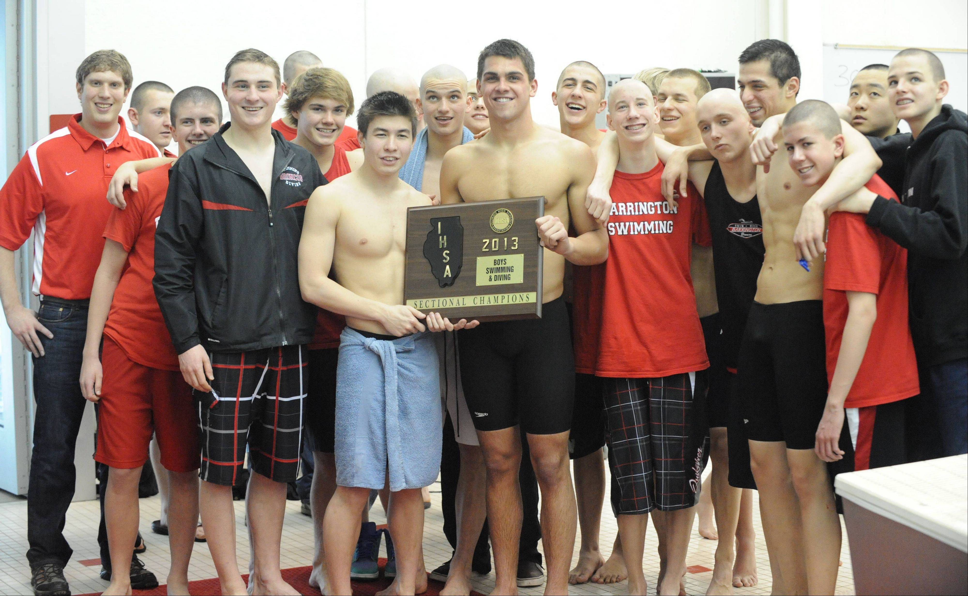 Barrington takes a moment to pose with its sectional championship hardware Saturday.