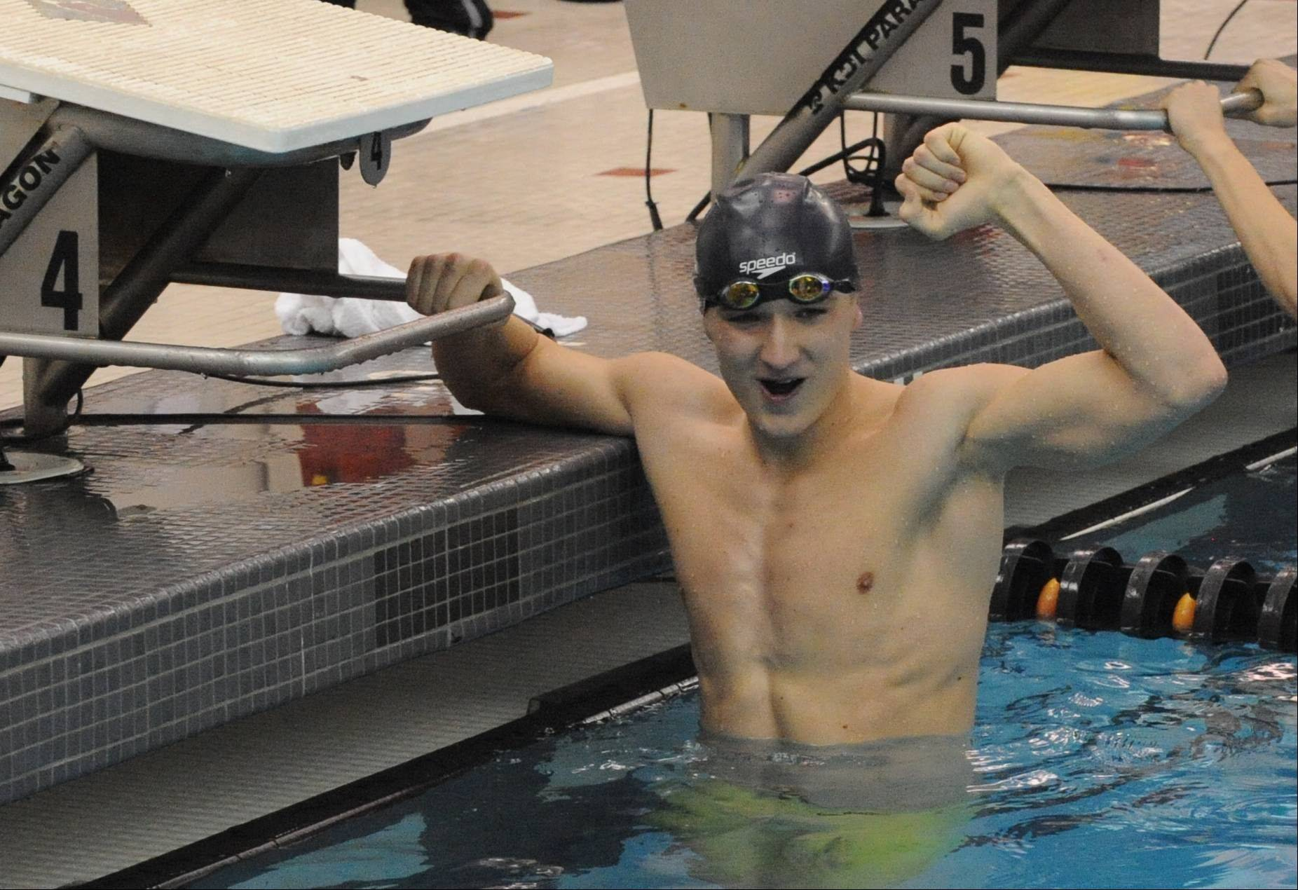 Fremd senior Andrew King likes what he sees after winning the 50 freestyle on Saturday at Barrington.