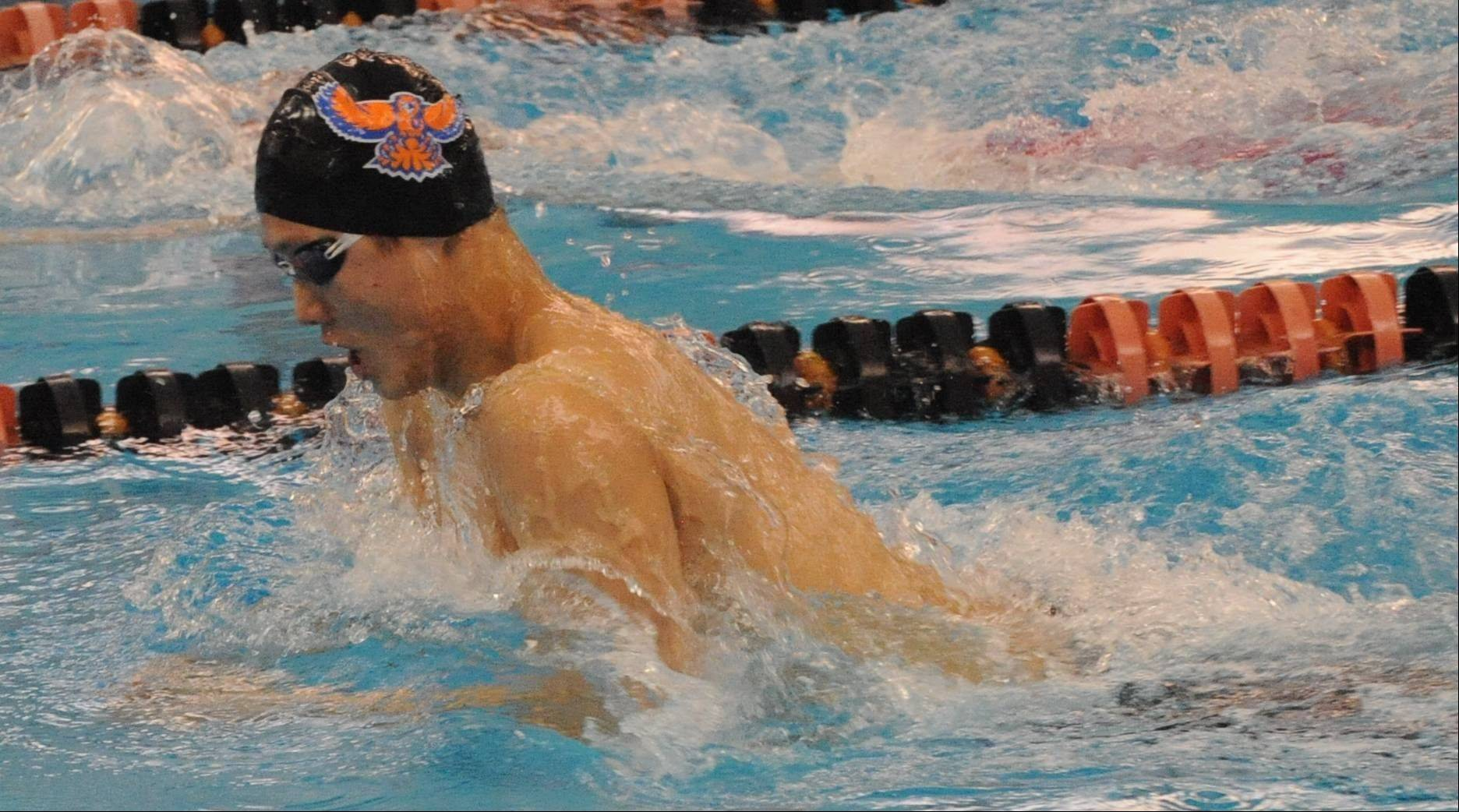 Hoffman Estates senior Sang Han delivers a victory in the 100-yard breaststroke on Saturday at Barrington.