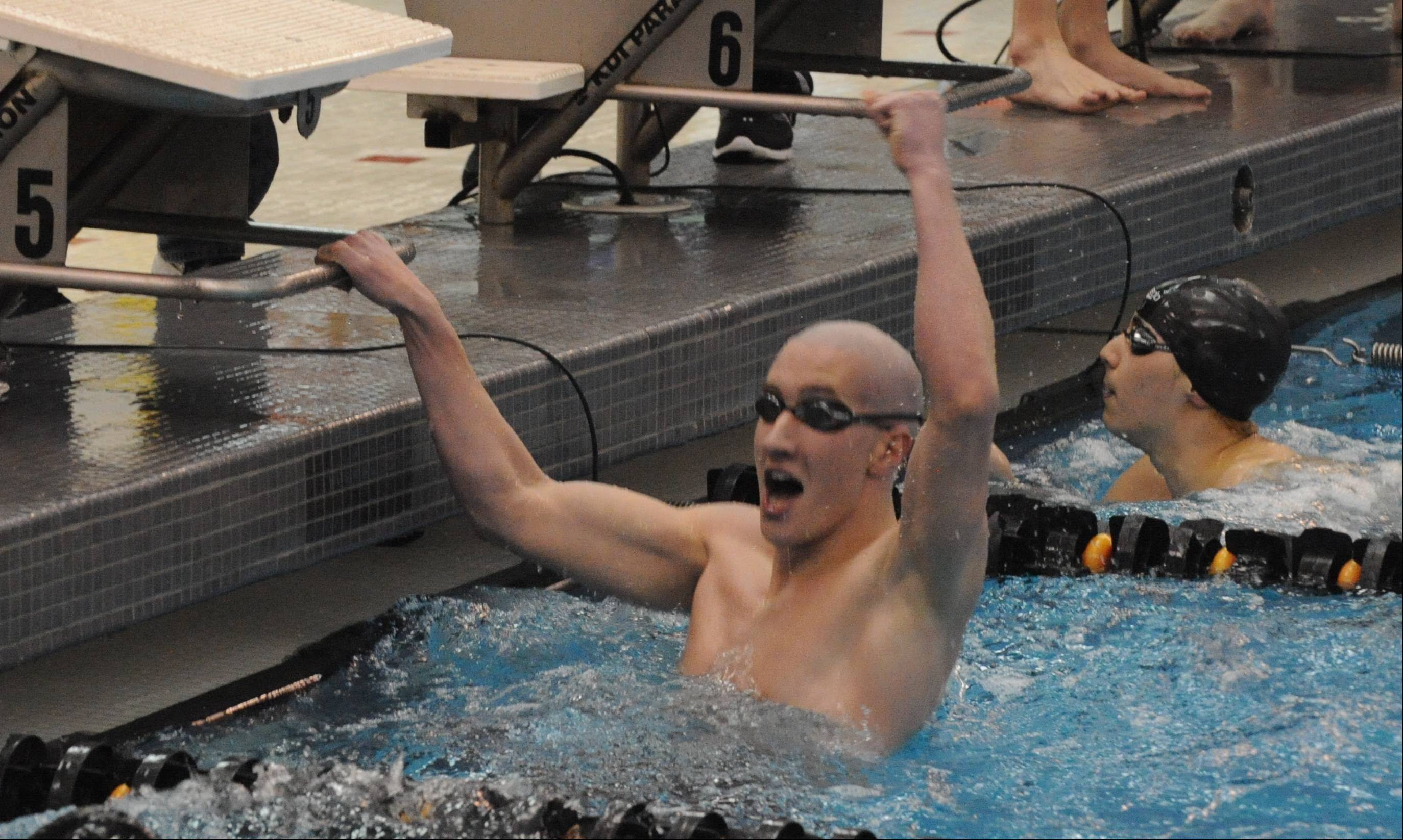 Hoffman Estates' Nick Jessee celebrates his winning effort in the 200-yard freestyle Saturday at Barrington.