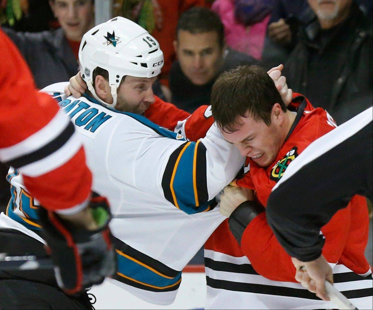 San Jose Sharks center Joe Thornton, left, and Blackhawks center Jonathan Toews fight during the first period of Friday night's 4-1 Hawks victory.