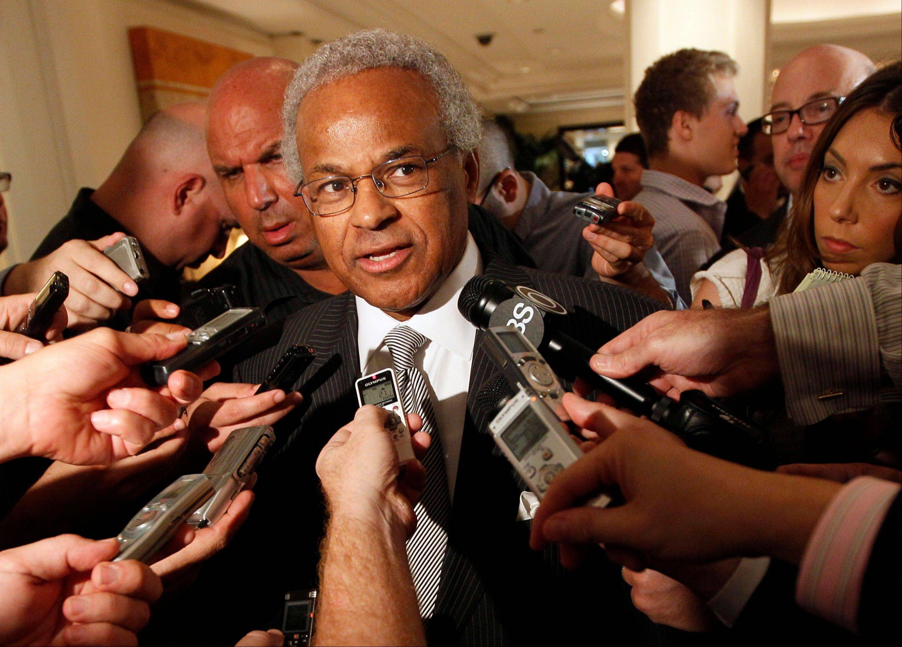FILE - In this June 30, 2011, file photo,�NBA Players Union chief Billy Hunter speaks to reporters after a meeting with the NBA in New York. Hunter has been unanimously voted out as executive director of the NBA players' association, Saturday, Feb. 16, 2013.