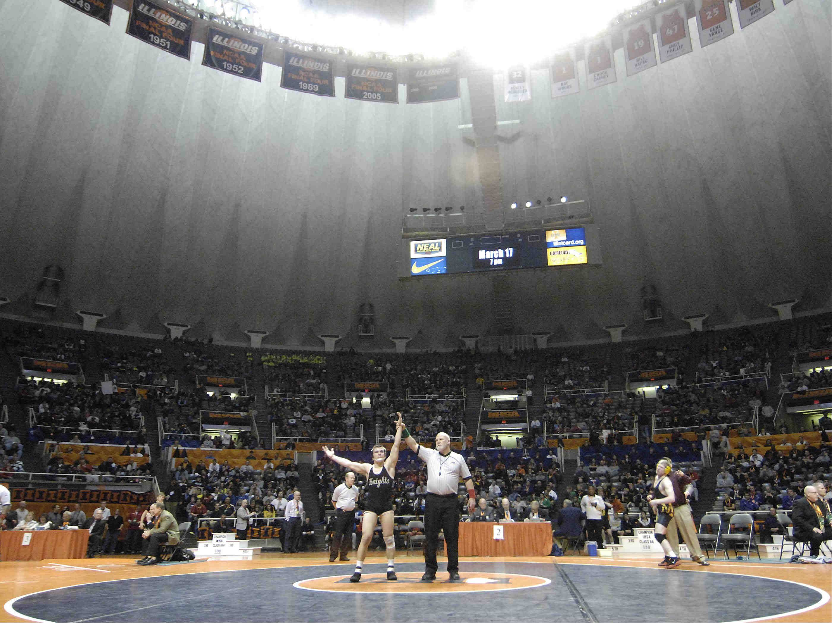 Kanelands's Dan Goress is declared the winner in the Class 2A 145-pound IHSA championship final wrestling match at Assembly Hall in Champaign Saturday. He defeated Michael Sepke of Lombard Montini.