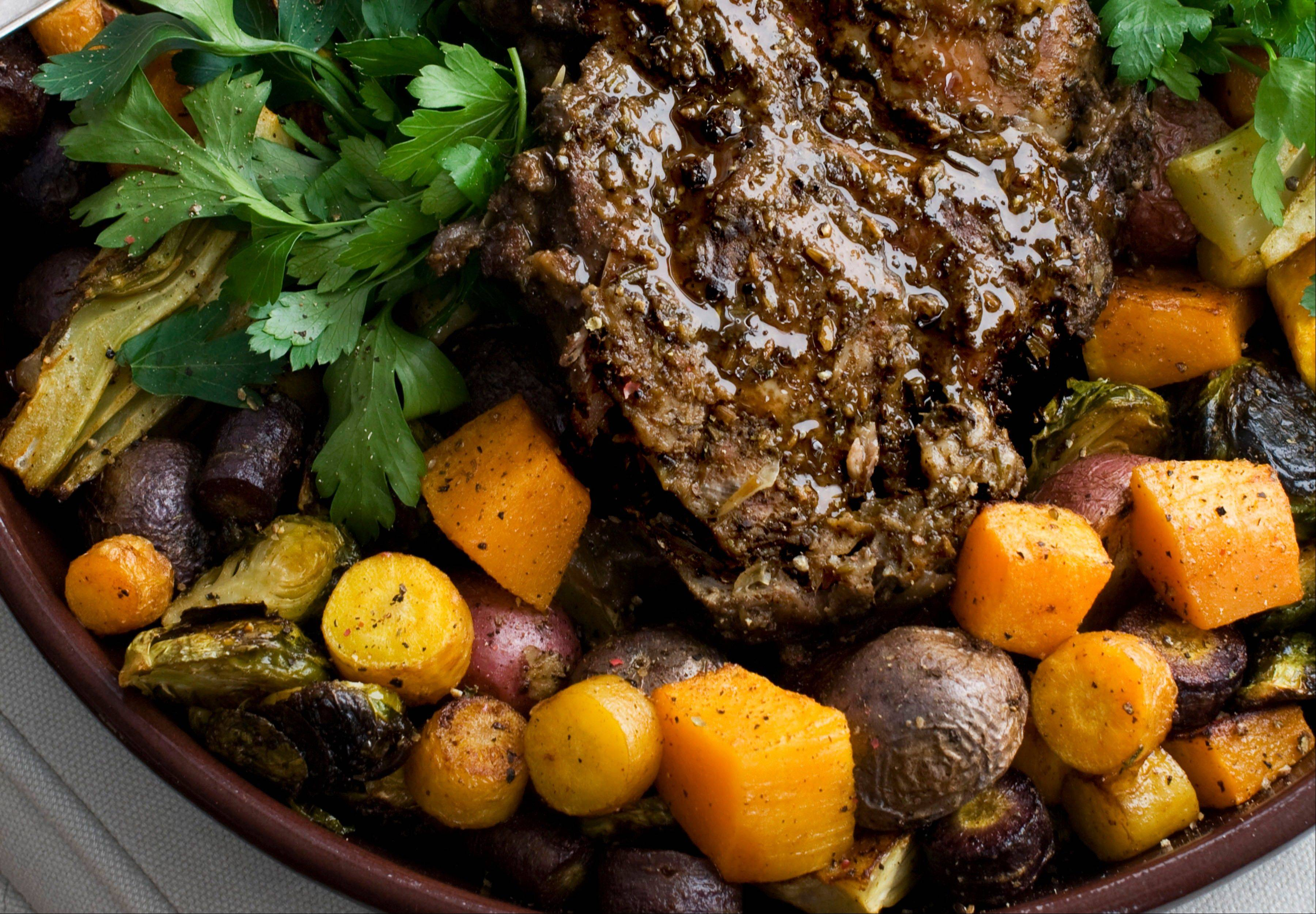 In this image taken on Jan. 28, 2013, roasted rosemary leg of goat is shown on a plate in Concord, N.H. (AP Photo/Matthew Mead)
