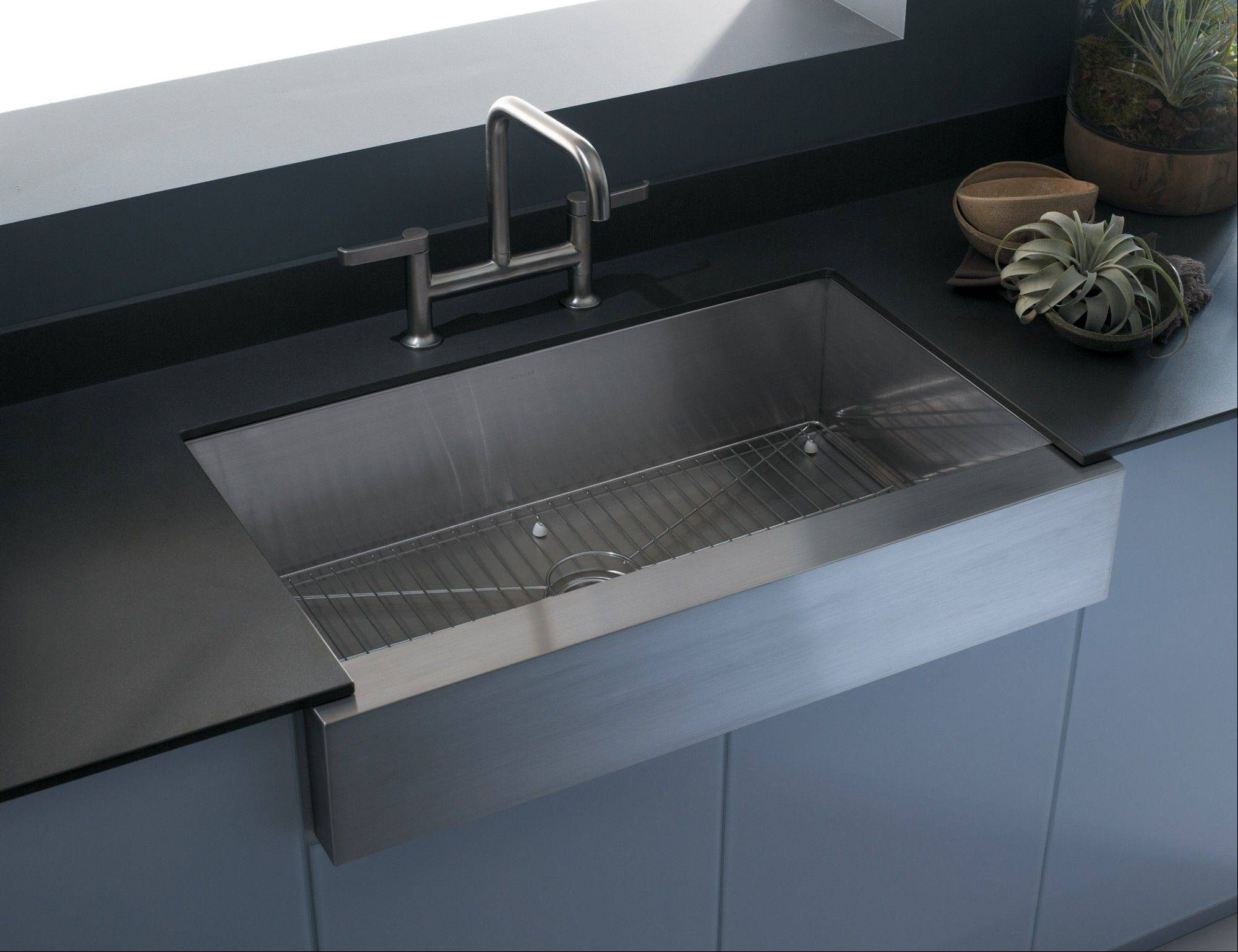 �Under mount� sinks are usually locked in under the counter, so in most cases the countertop would be removed along with the sink.