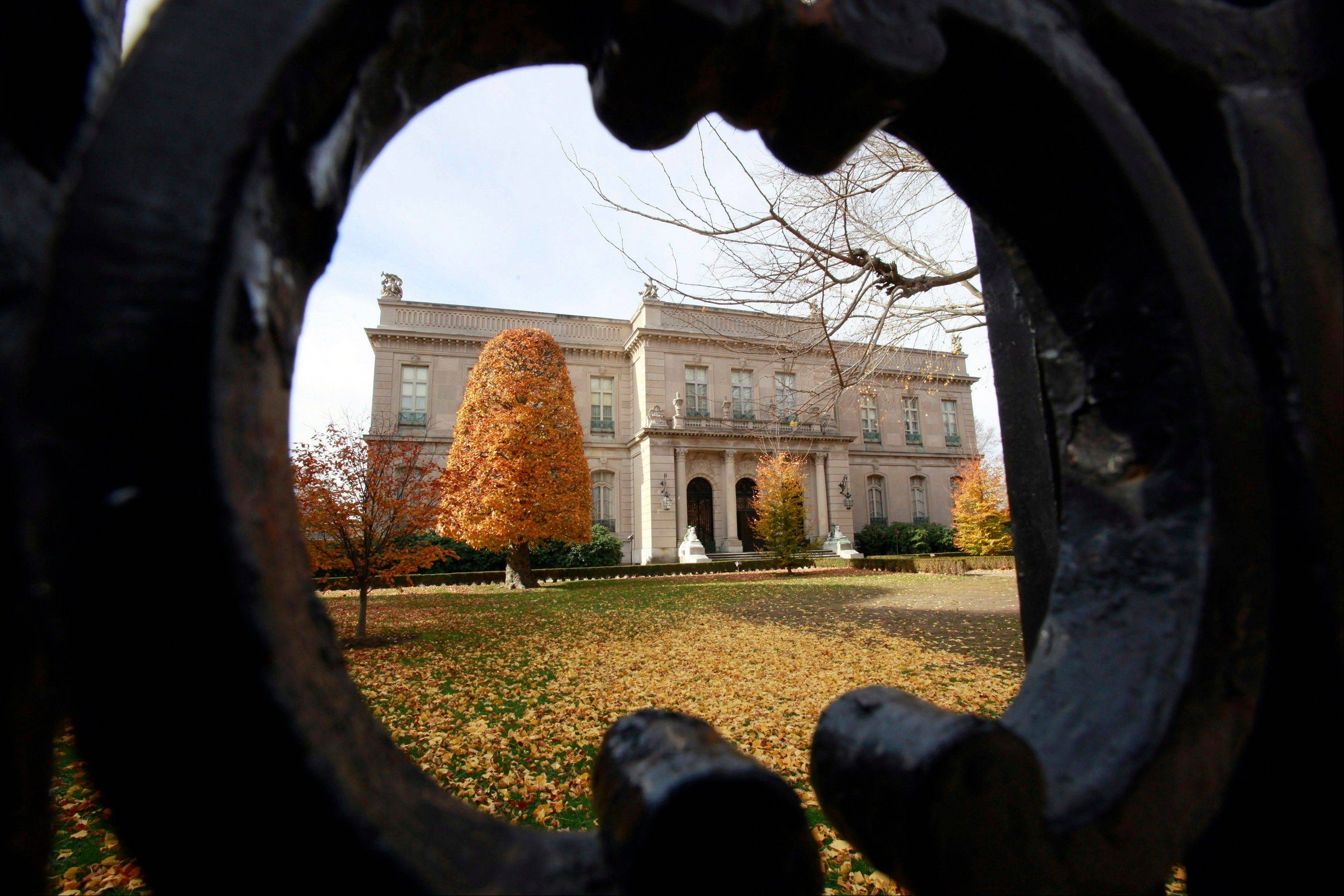 The Elms mansion as seen through an opening in an iron fence, in Newport, R.I. Newly discovered photographs, documents and family histories have inspired the creation of a tour about servants at The Elms.