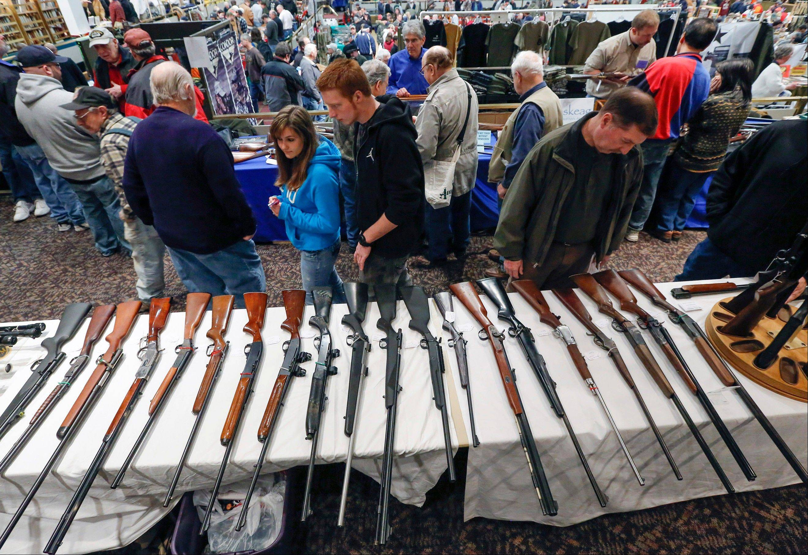 Guns are displayed on a table on display during the annual New York State Arms Collectors Association Albany Gun Show in Albany, N.Y., Jan. 26.