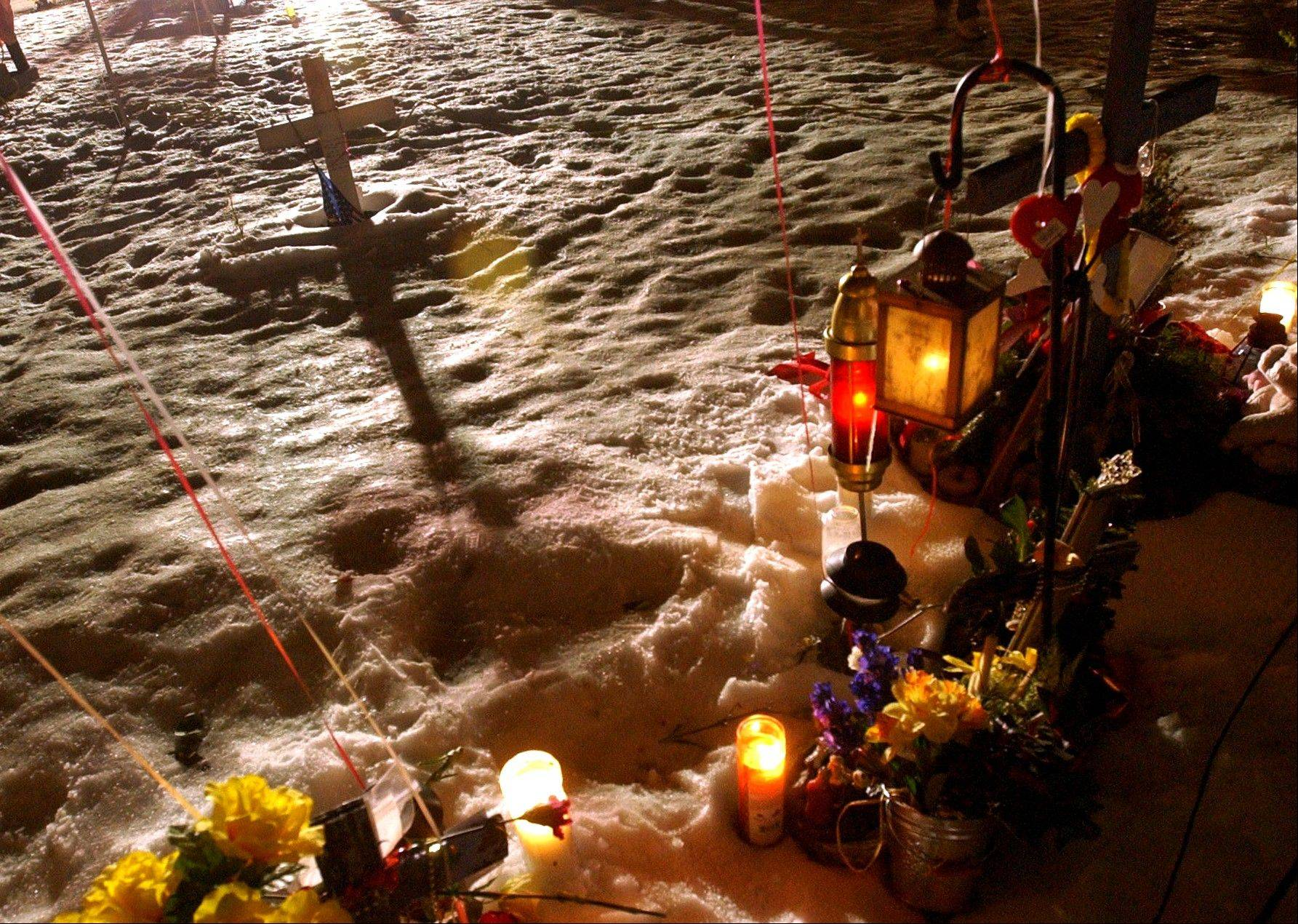 Associated Press This Feb. 20, 2004, file photo, shows a makeshift memorial at the former site of The Station nightclub, marking the one-year anniversary of a fire that killed 100 people at the club in West Warwick, R.I. Survivors and family members of the 100 people killed in a Rhode Island nightclub fire are observing the 10th anniversary of the blaze, which is Wednesday, Feb. 20, 2013, with a memorial service scheduled for Sunday. (