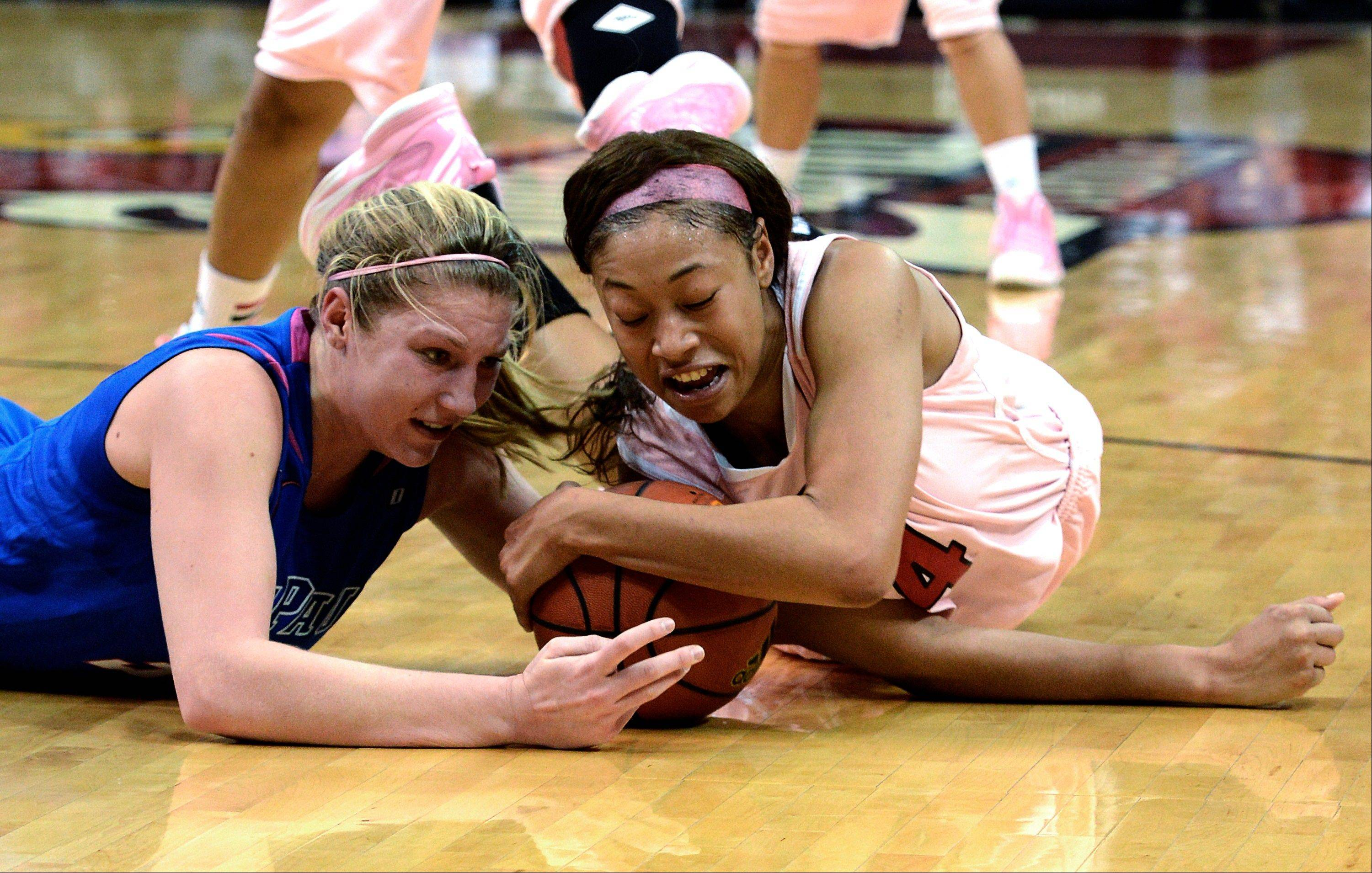 Louisville�s Antonia Slaughter, right, battles DePaul�s Megan Podkowa for a loose ball during the second half Sunday in Louisville, Ky. Louisville won 81-55.