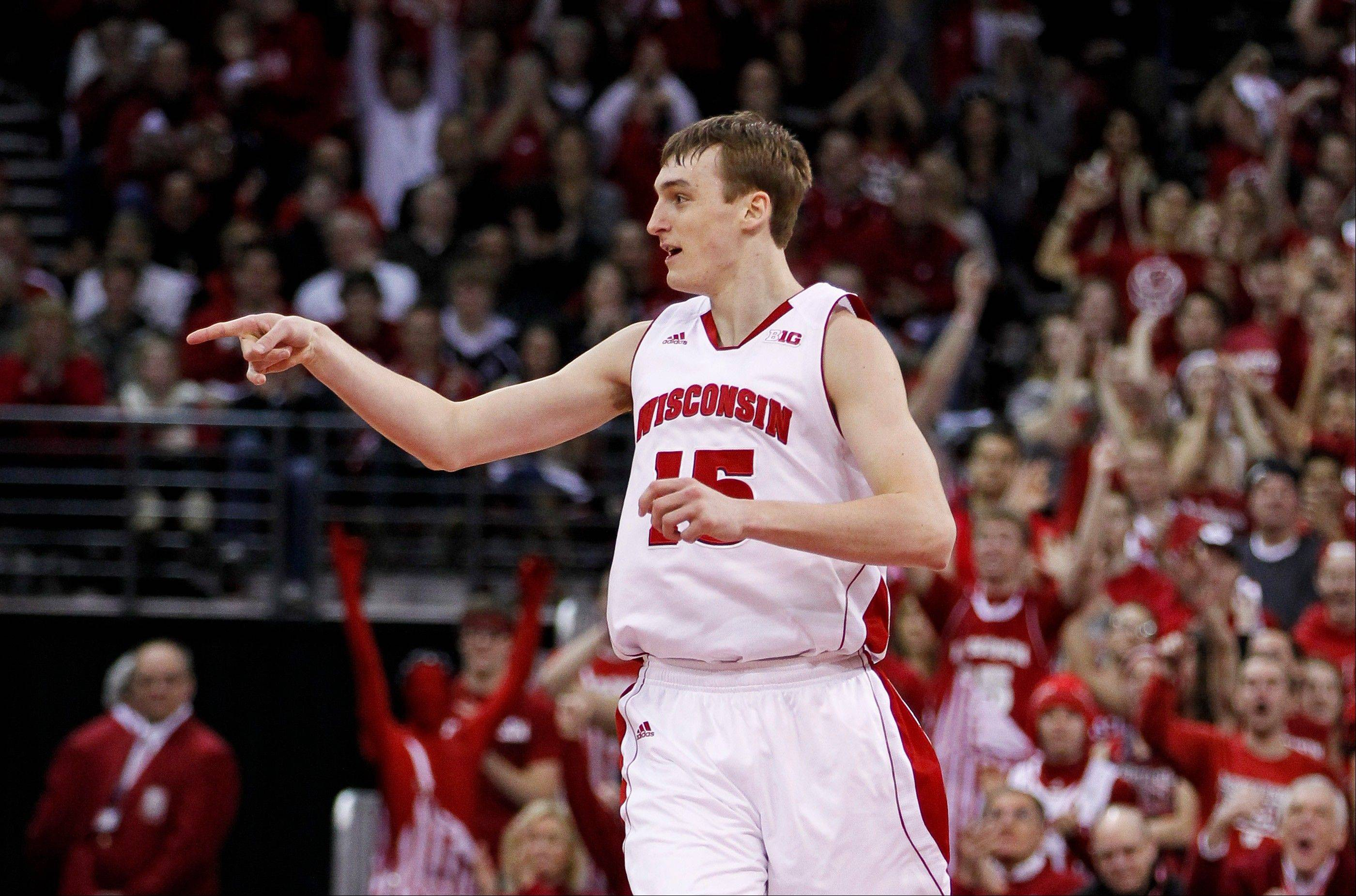 Wisconsin's Sam Dekker celebrates a 3-point basket against Ohio State during the second half Sunday in Madison, Wis. Wisconsin beat Ohio State 71-49.